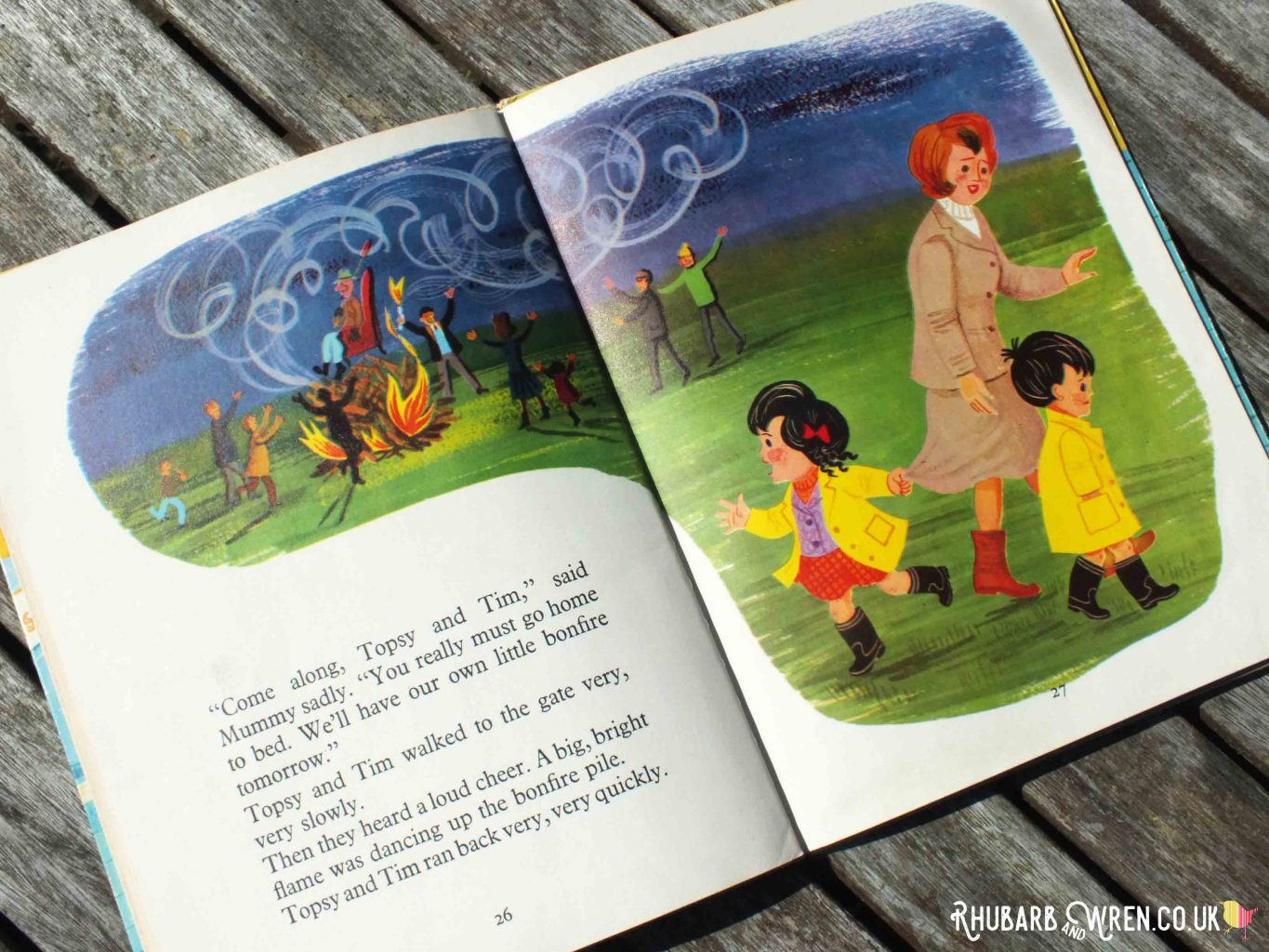 Illustration of Topsy and Tim with their mother, pointing to bonfire, from Topsy and Tim's Bonfire Night