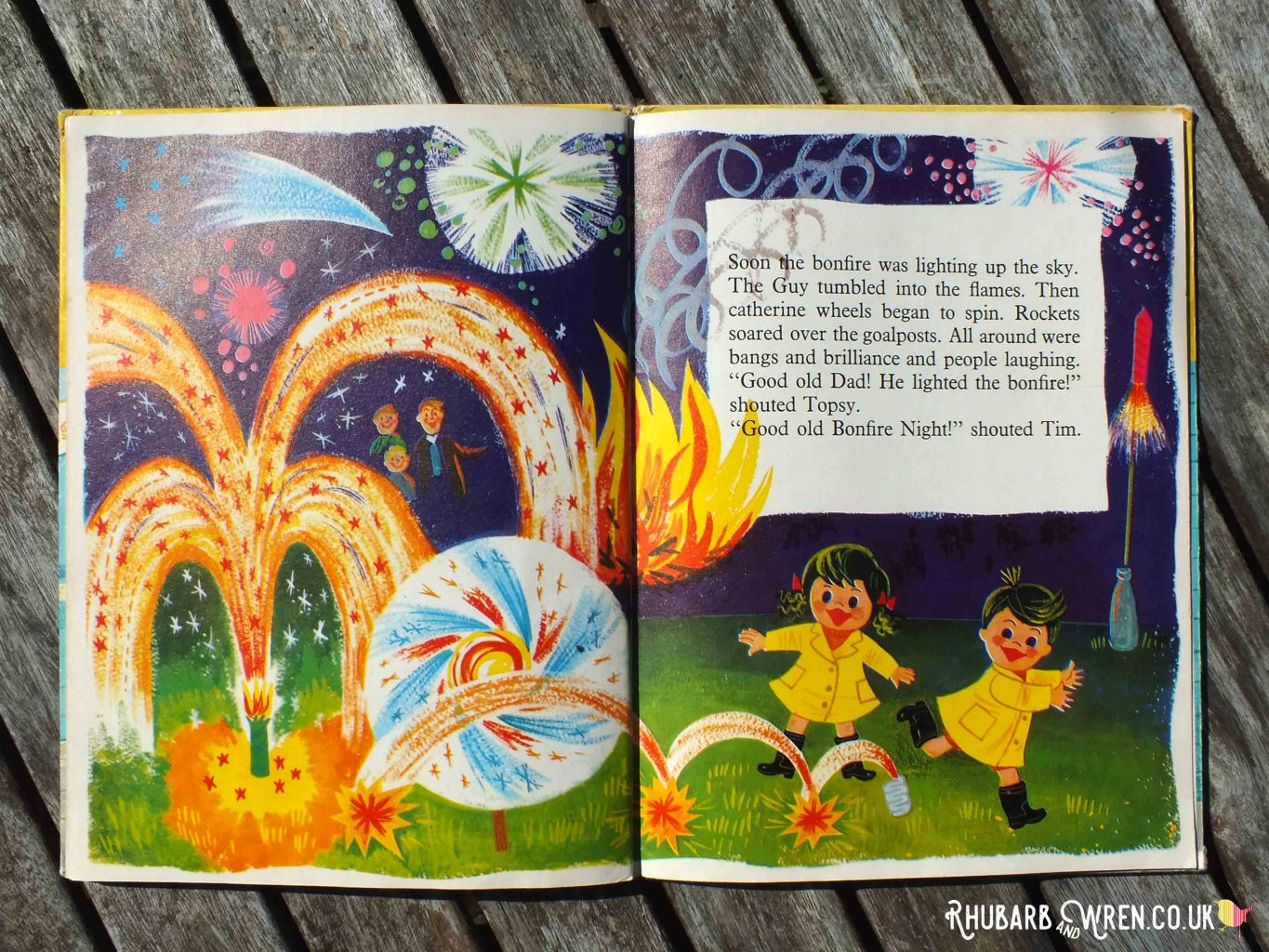 Illustration of Topsy and Tim dancing among exploding fireworks, from Topsy and Tim's Bonfire Night