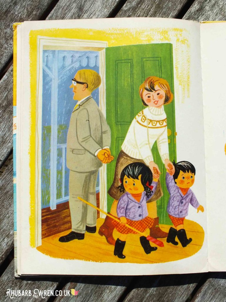 Topsy and Tim holding firework and sheltering from the rain in Topsy and Tim's Bonfire Night vintage book.