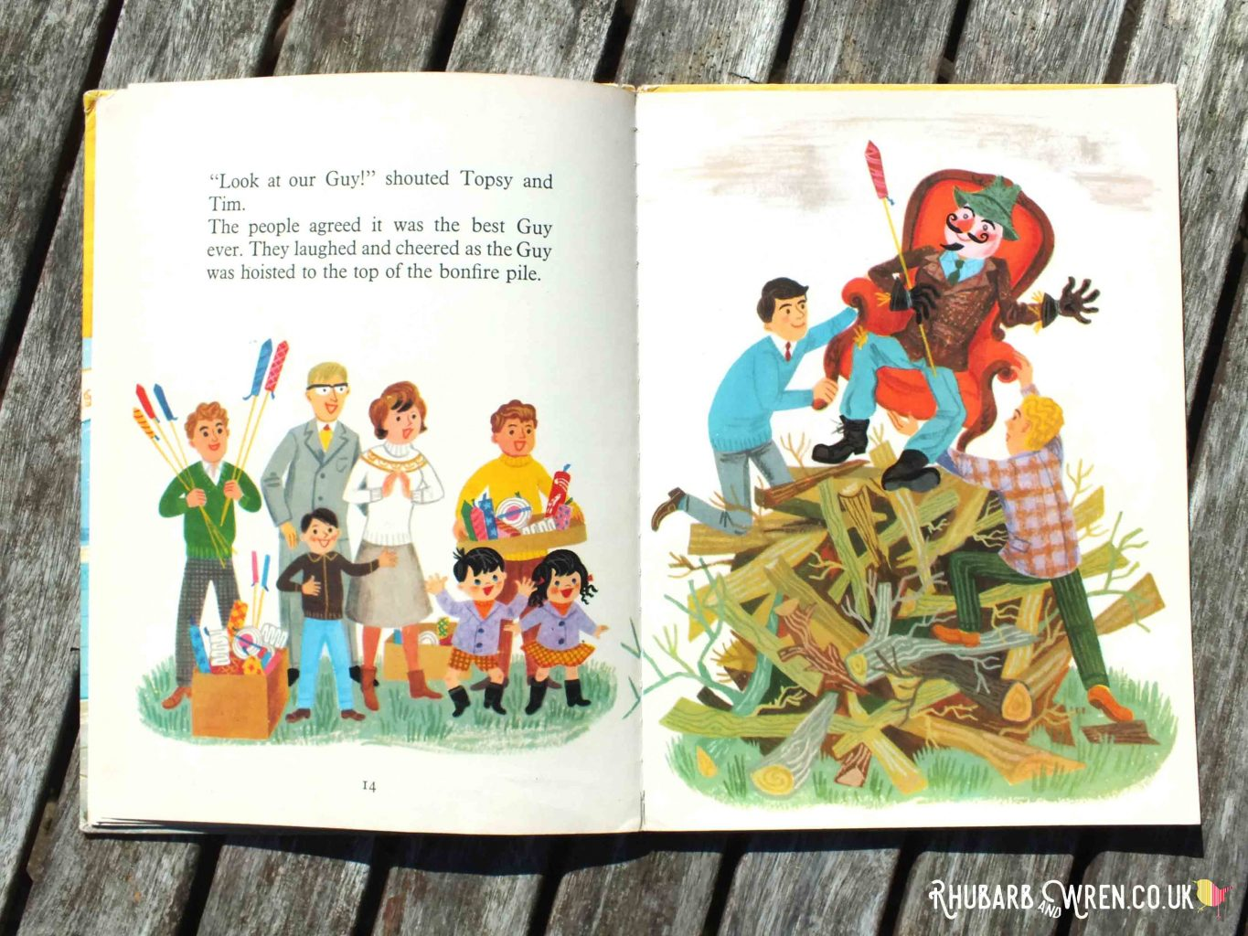 Illustration of a Guy holding fireworks being placed on bonfire in Topsy and Tim's Bonfire Night