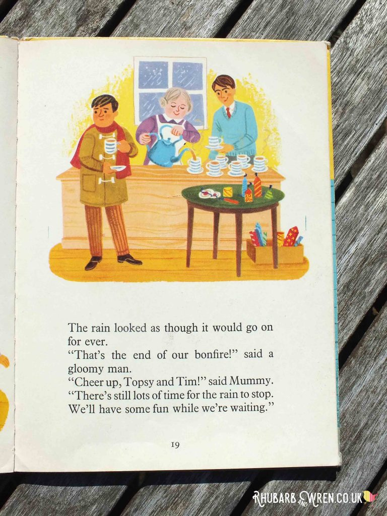 Illustration of people drinking tea, sheltering from the rain, fireworks under table, in Topsy and Tim's Bonfire Night.