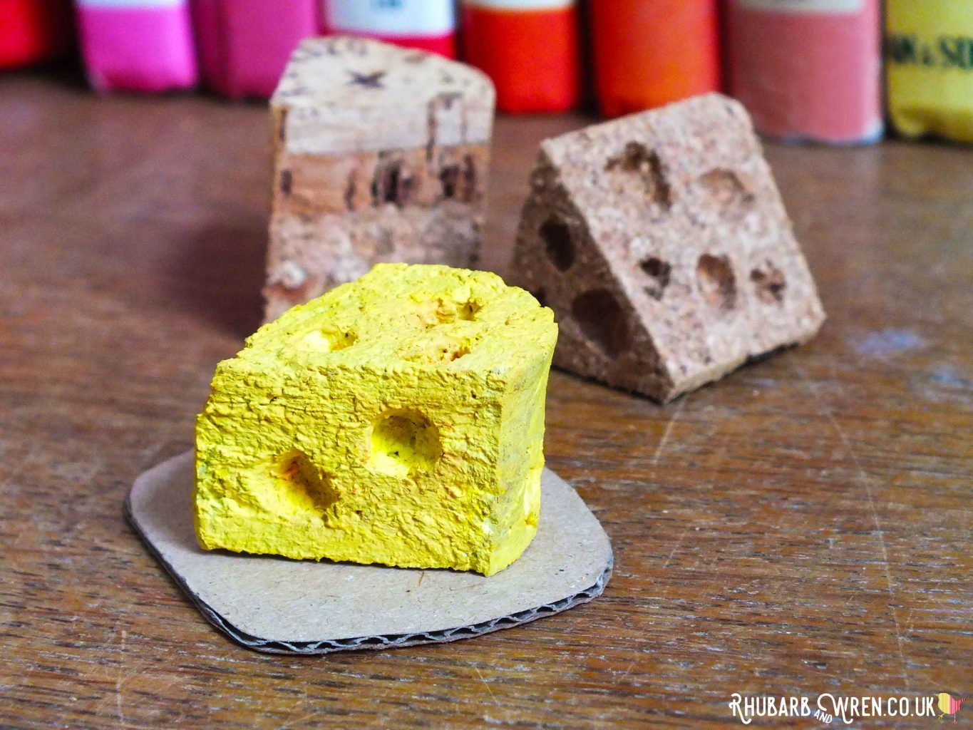 Doll food wedge of cheese made from painted wine cork