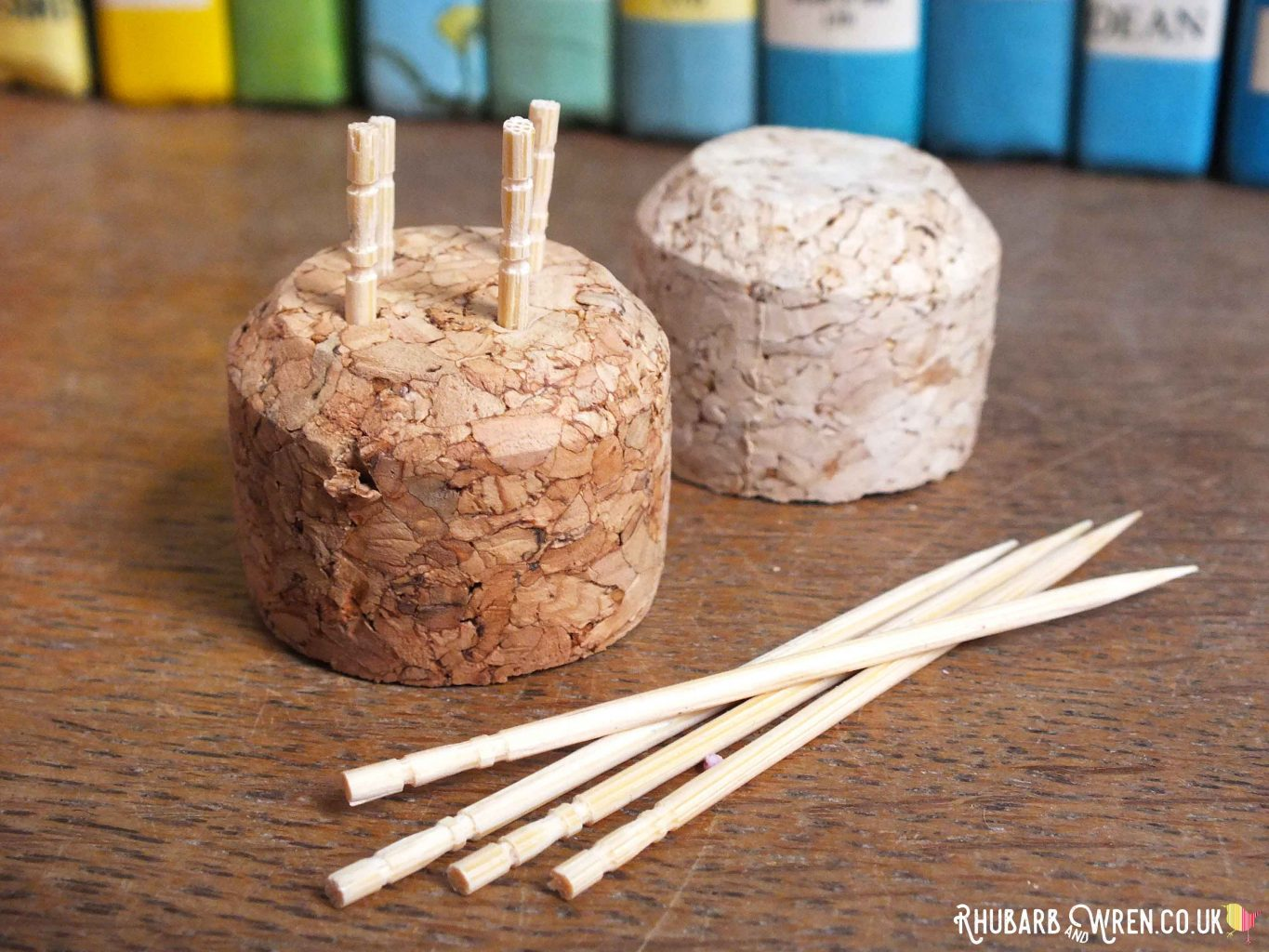 The top of a wine cork with sections of toothpick stuck in to make a doll food cake