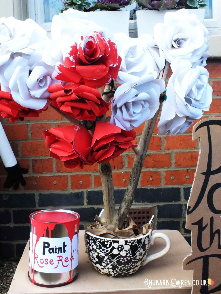 White paper rose tree with some half-painted red