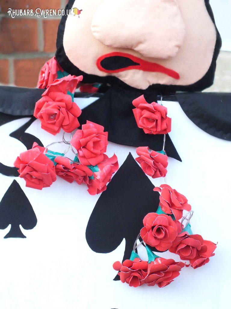 Red rose light garland for Alice in Wonderland scarecrows