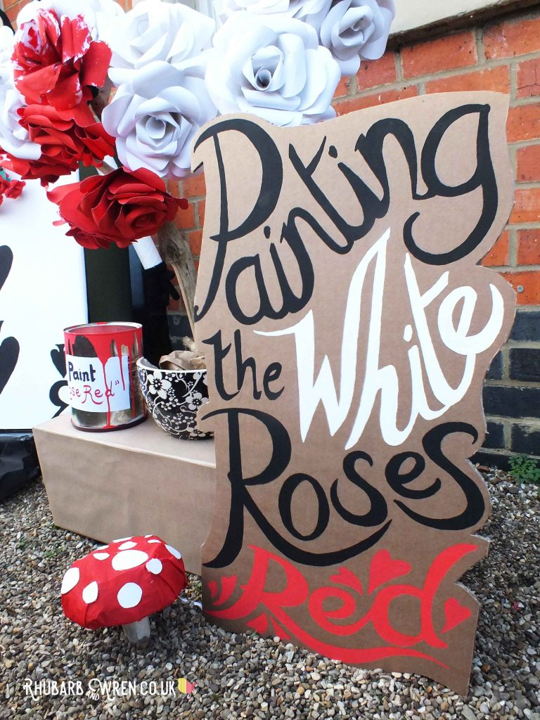 Hand-painted sign 'Painting the White Roses Red' for Alice in Wonderland scarecrows display