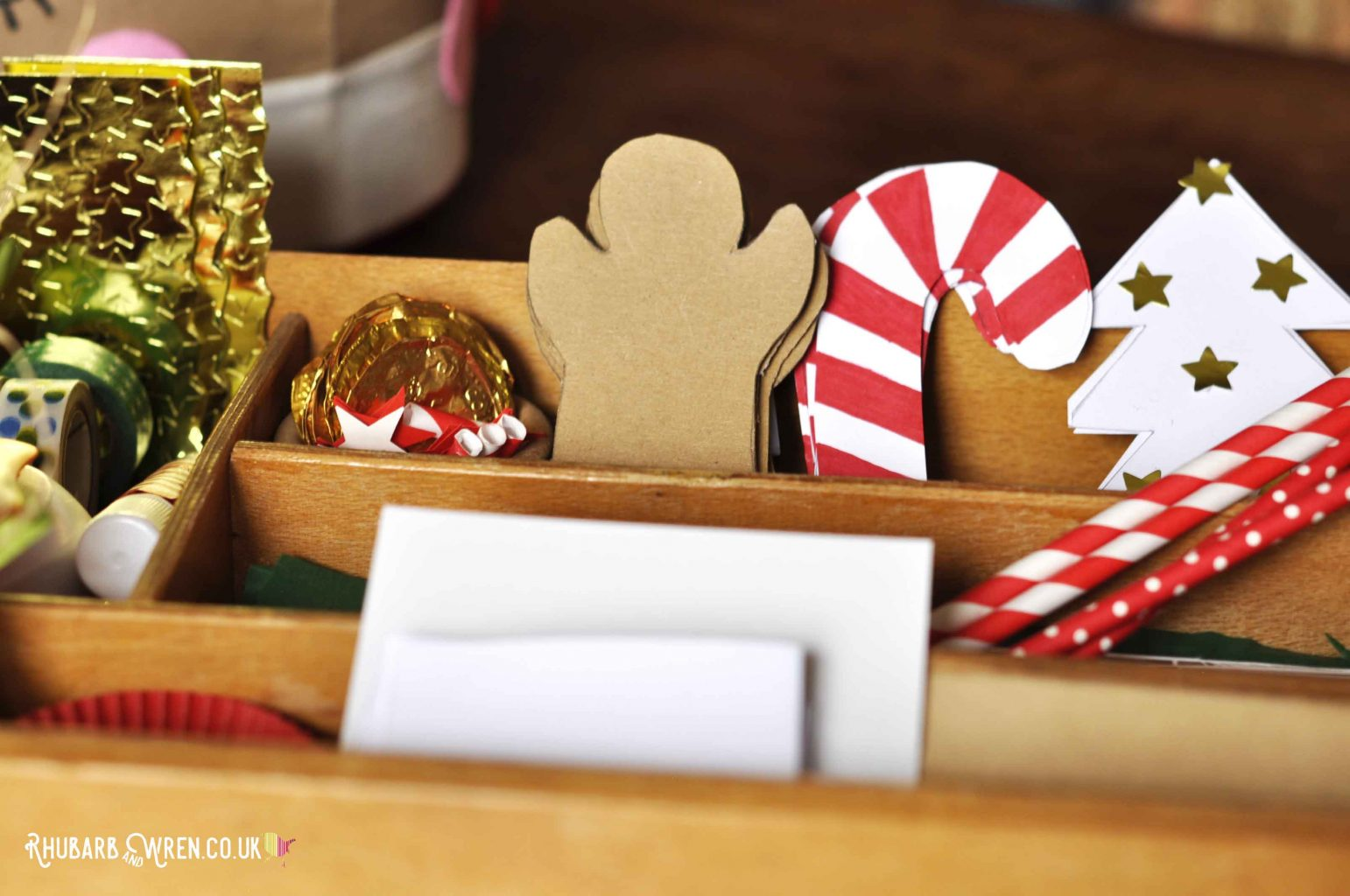 Tray full of card and paper cut into christmas shapes for children's crafts