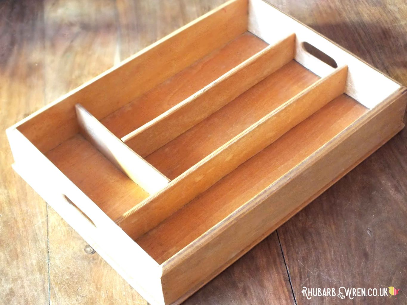 Empty vintage wooden cutlery tray with compartments and handles