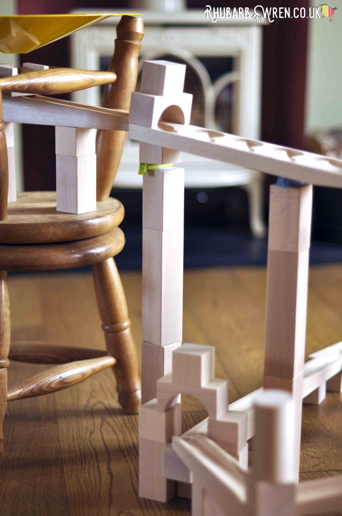 A tower of wooden blocks supporting marble run track
