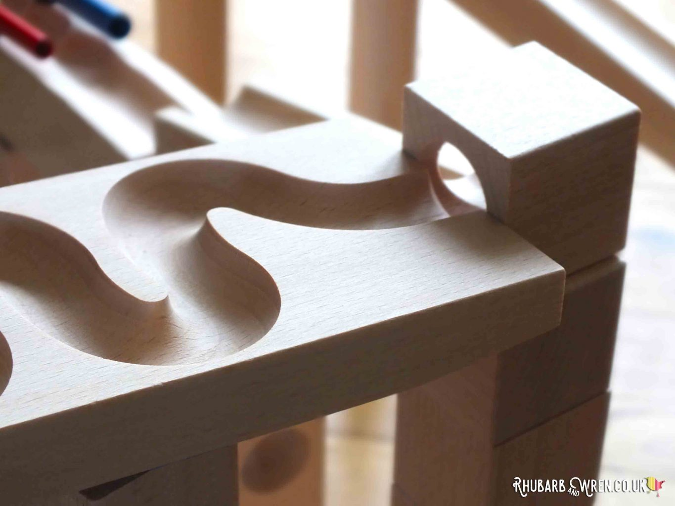 close-up of carved groove winding through a HABA wooden marble run block