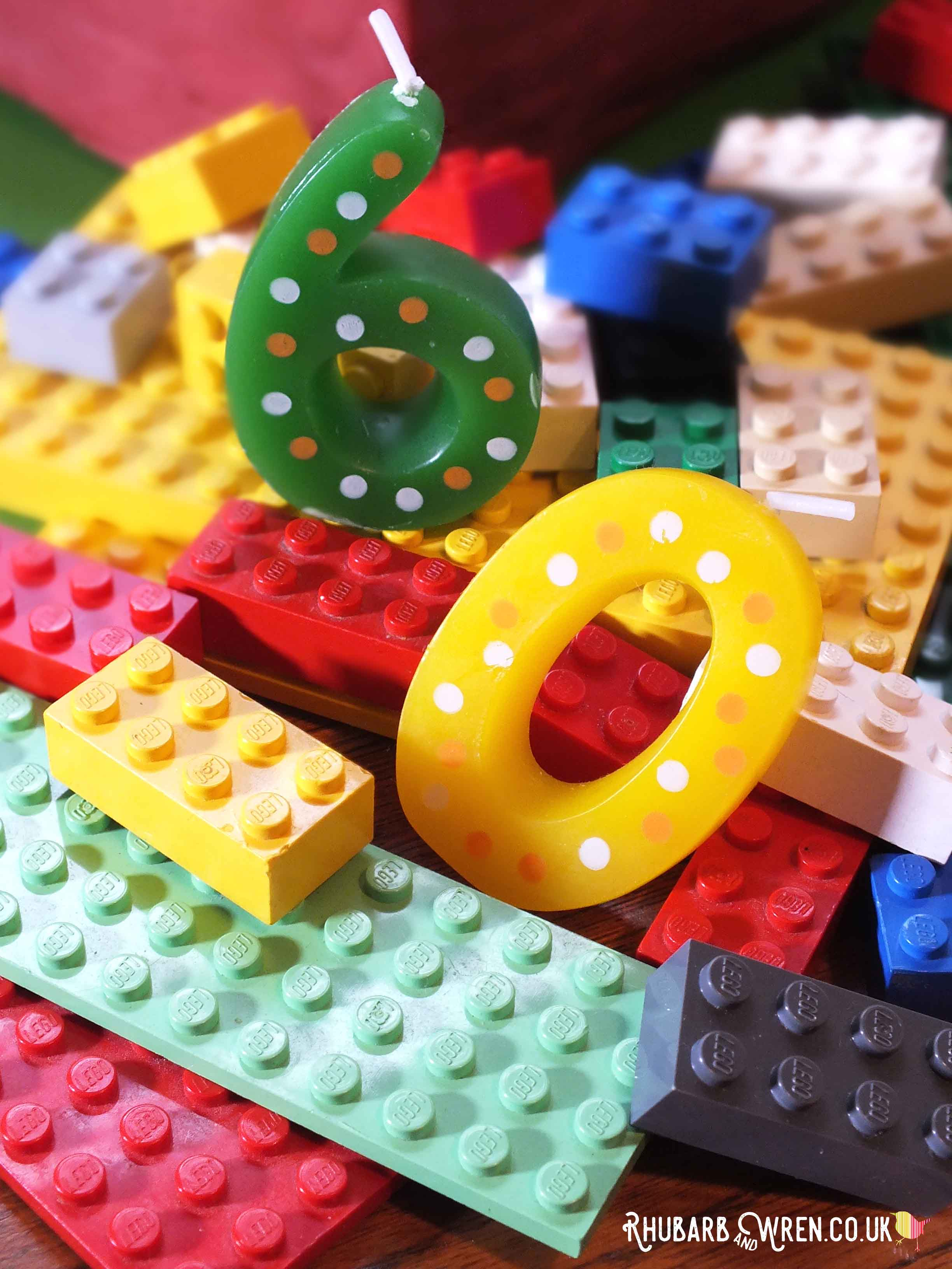 60th birthday candles in a pile of lego bricks
