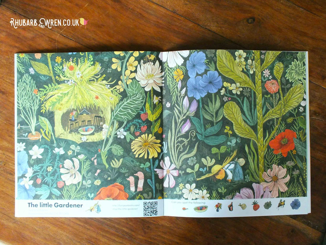 Double-page spread in Okido magazine - a 'find foxy' activity. Artwork called 'The Little Gardener'