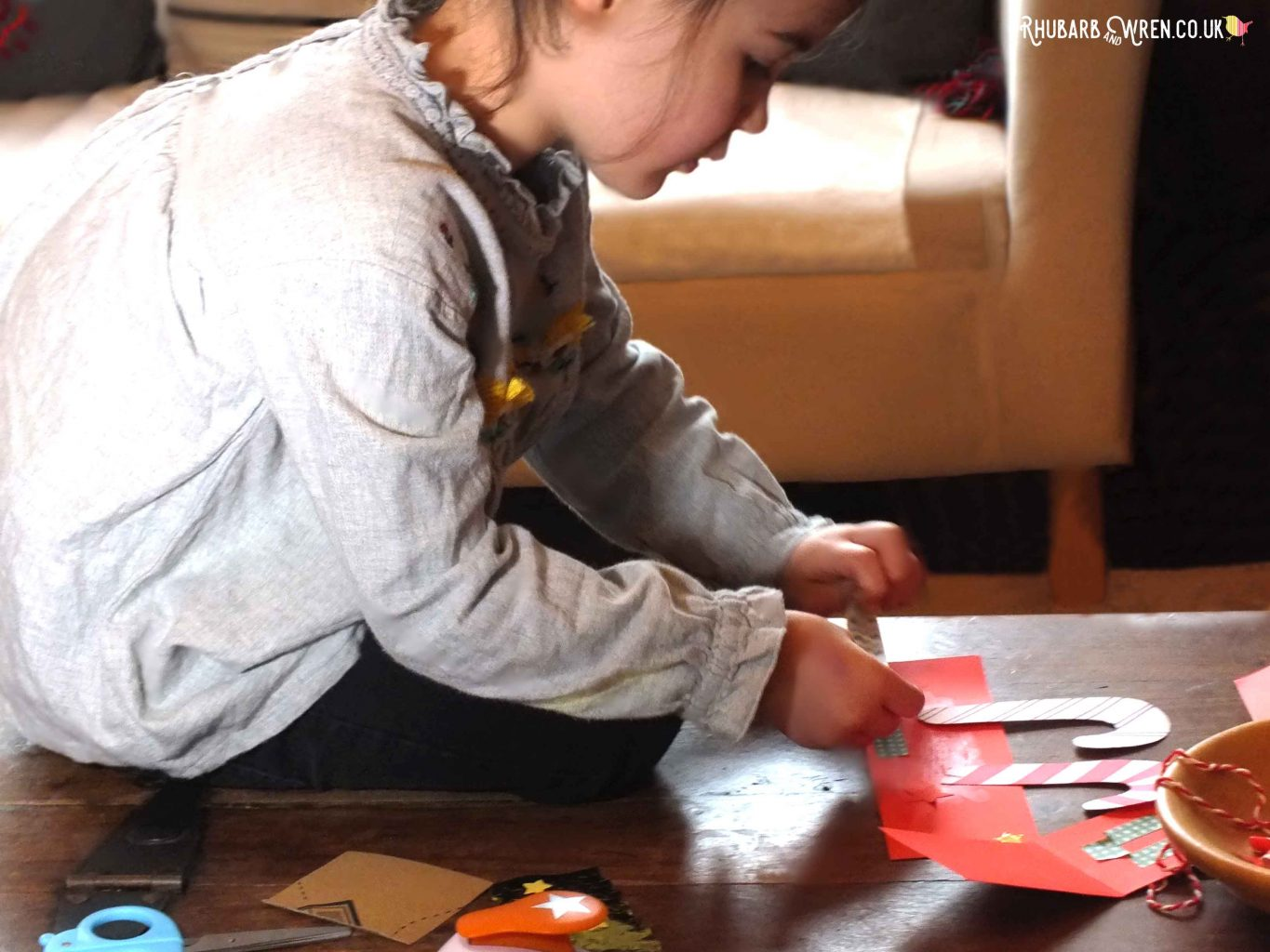 child making christmas crown with paper and washi tape
