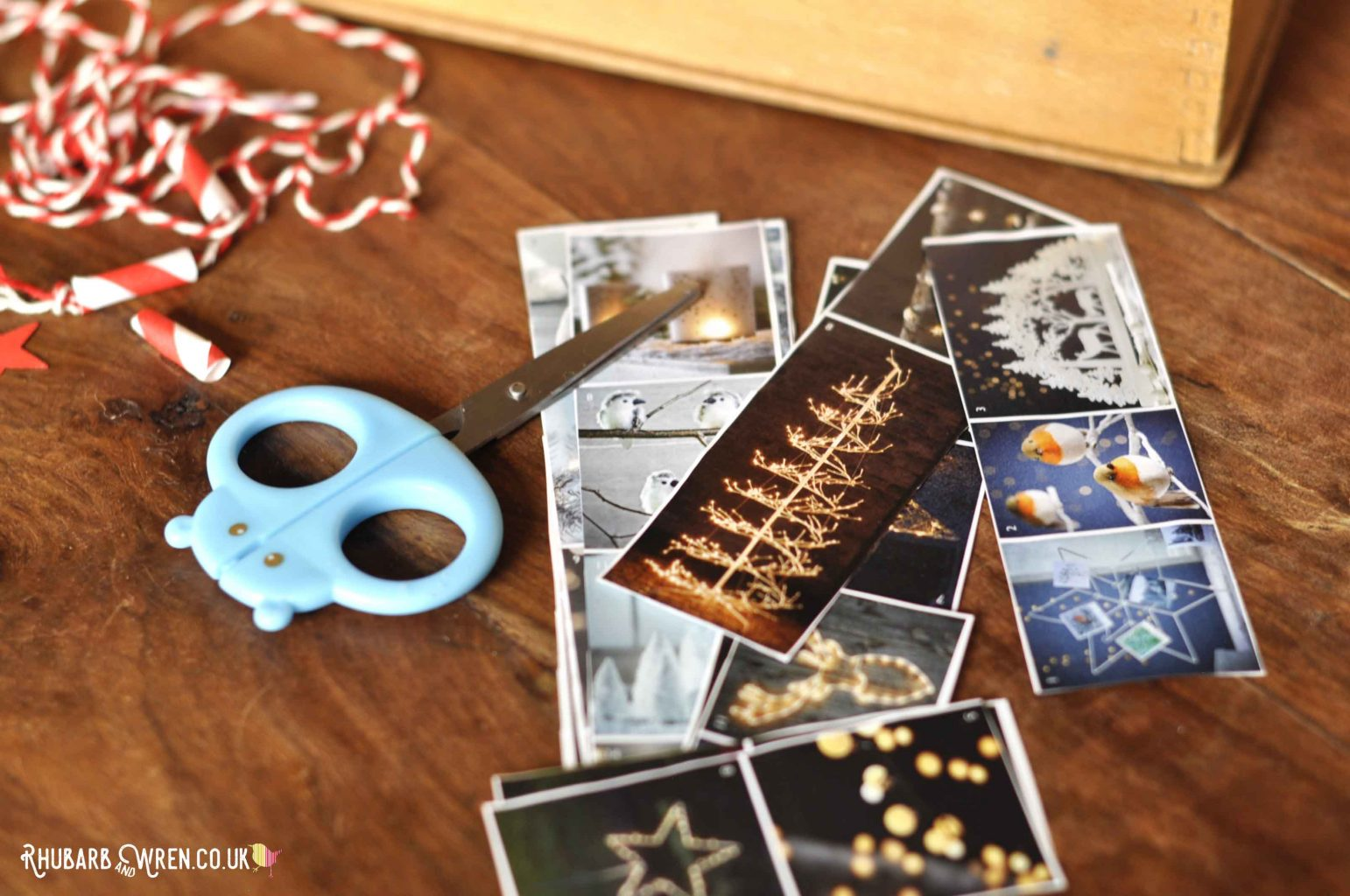 strips of pictures from christmas catalogues with kids' scissors