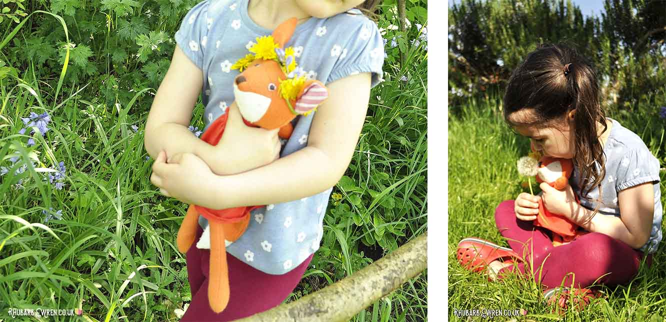 Girl hugging Hazel Village soft toy, Flora Fox.