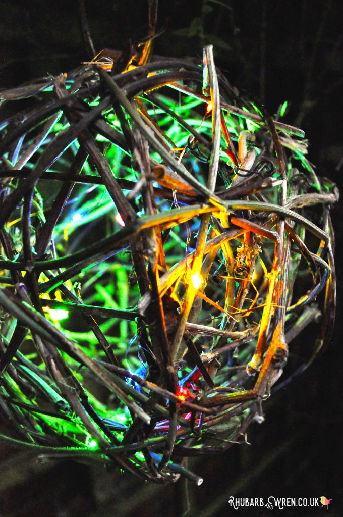 Twig ball lantern with multicolour lights - close up