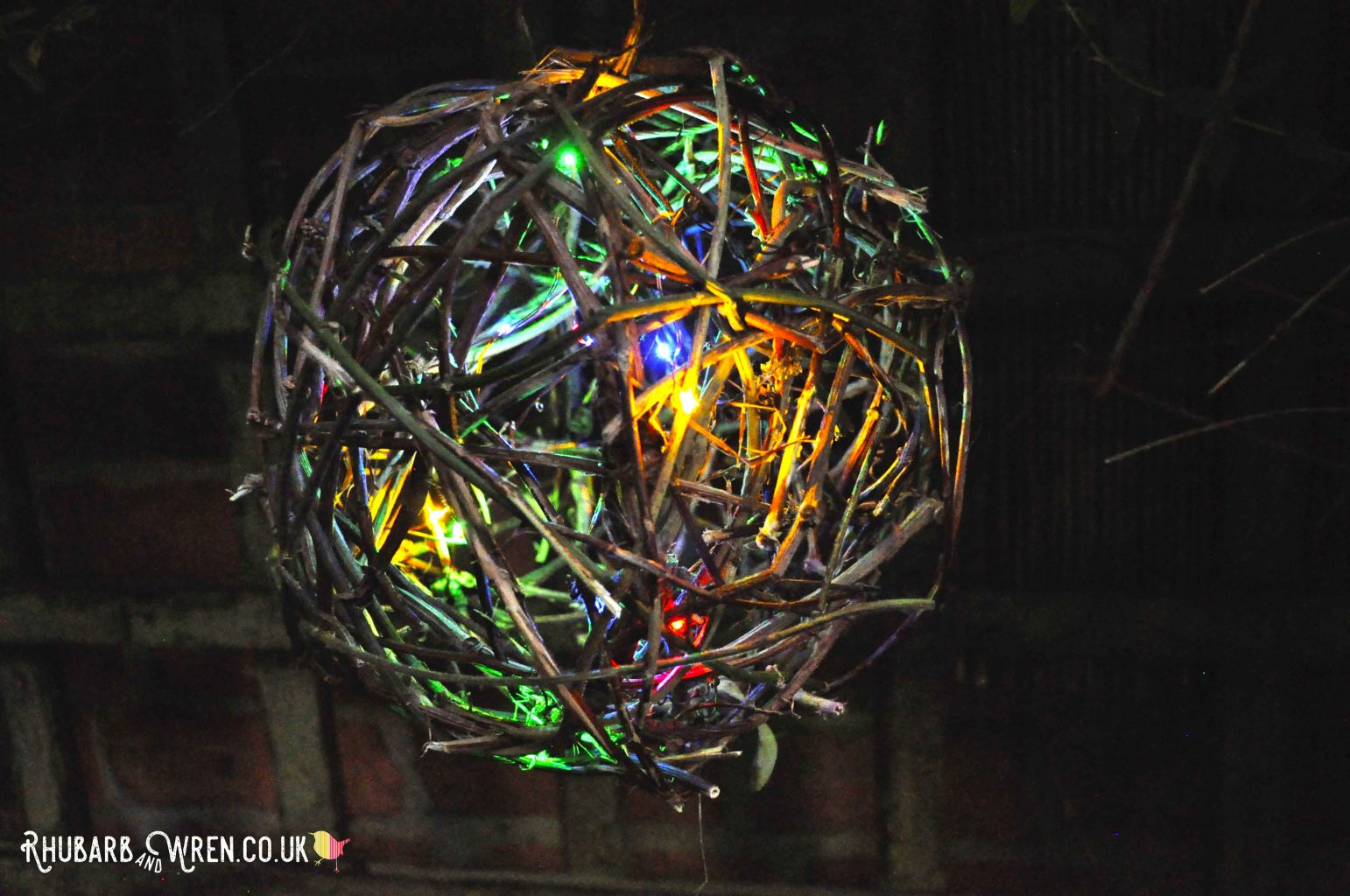 twig ball lantern with multicolour LED fairy lights