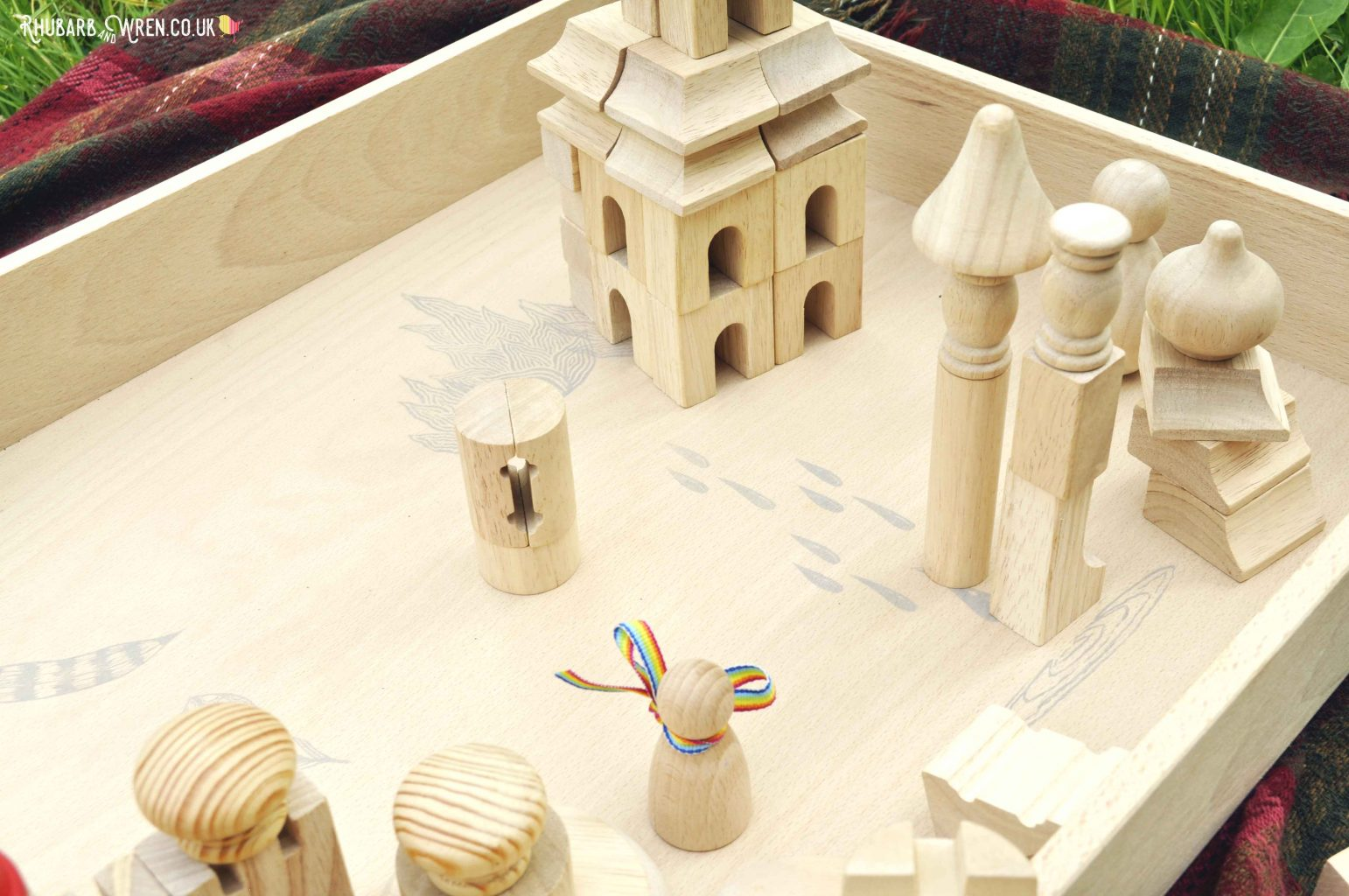 Wooden building blocks in a Grapat free-play box