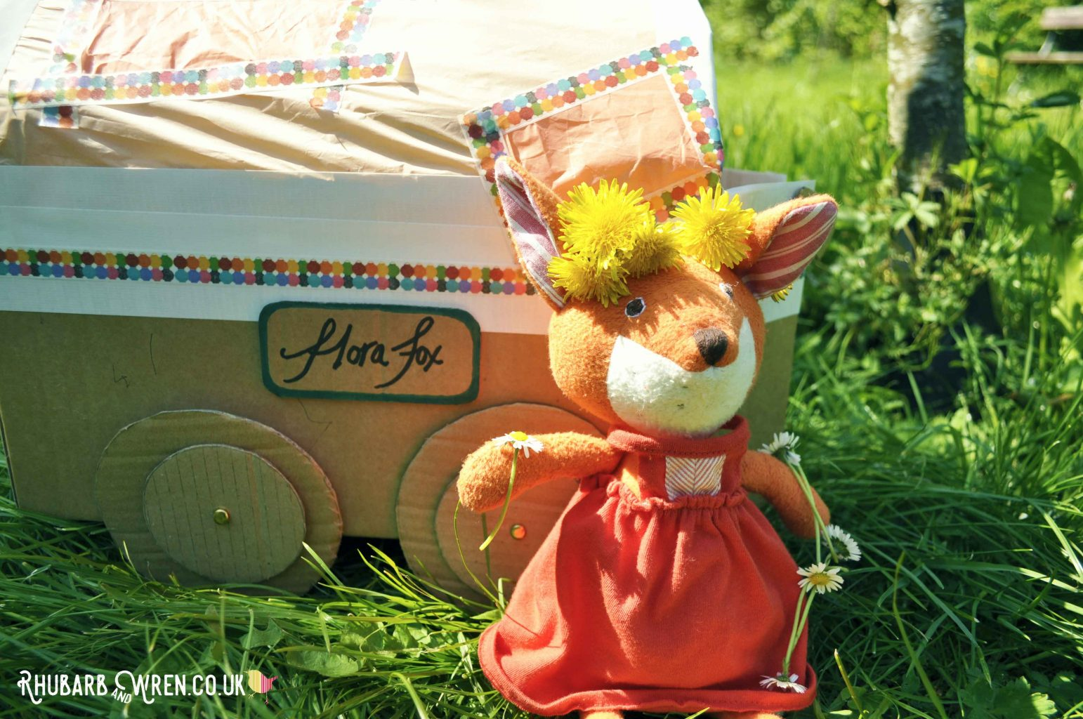 Hazel Village soft toy, Flora Fox, wearing a dandelion crown