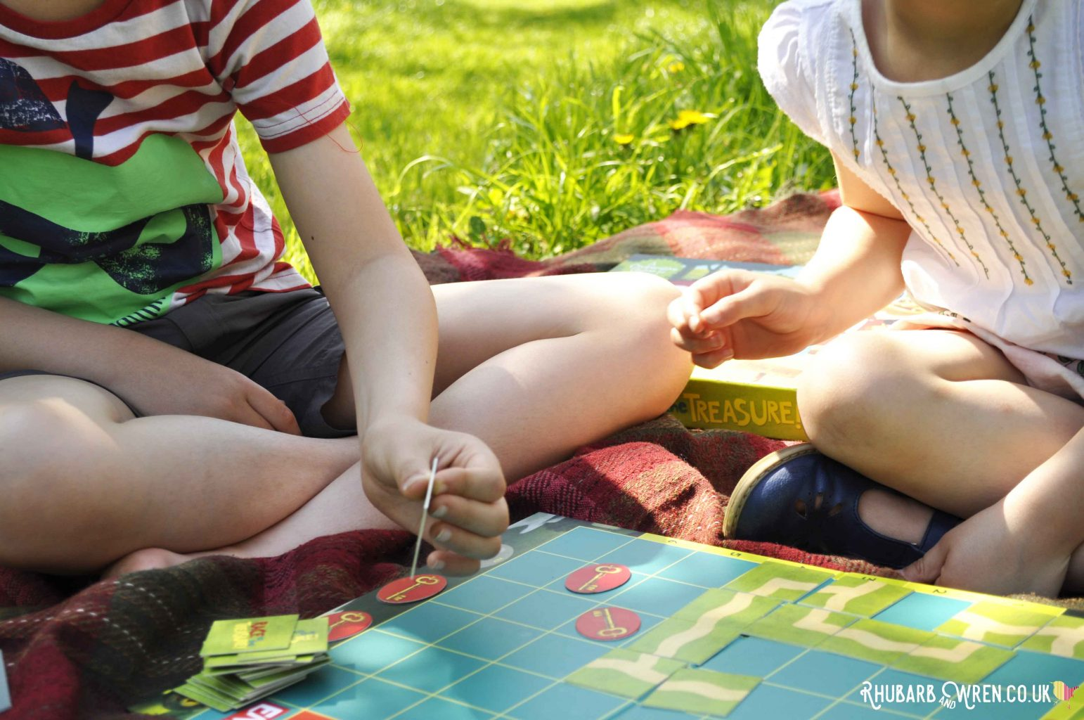 Kids playing Peaceable Kingdom board game