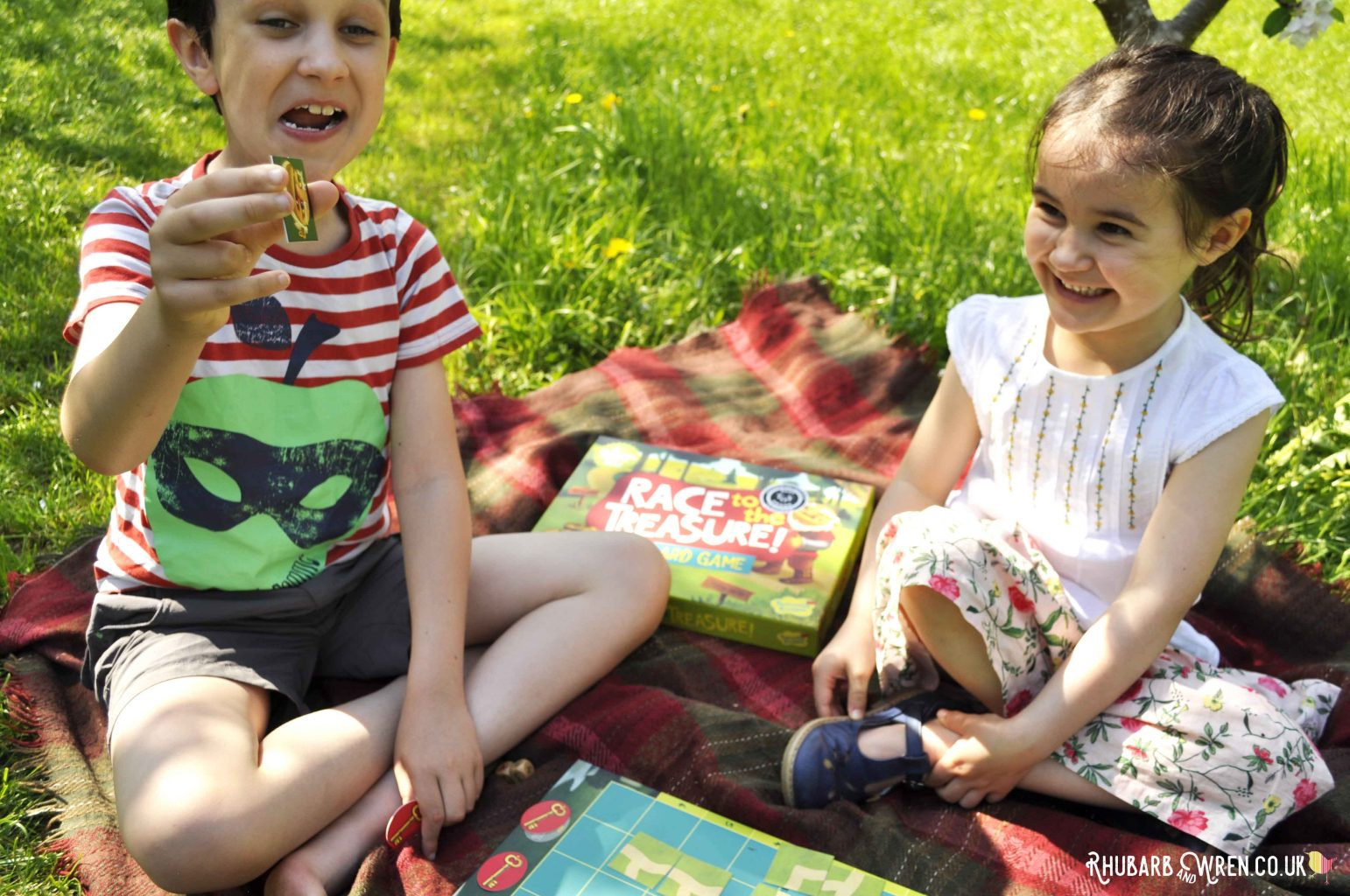 Children laughing playing Peaceable Kingdom board game 'Race to the Treasure'