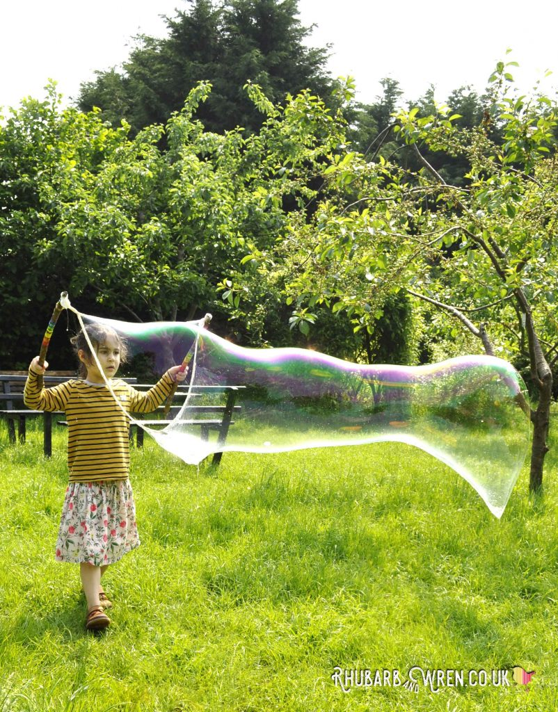 Giant bubbles made with diy tri-string giant bubble wand