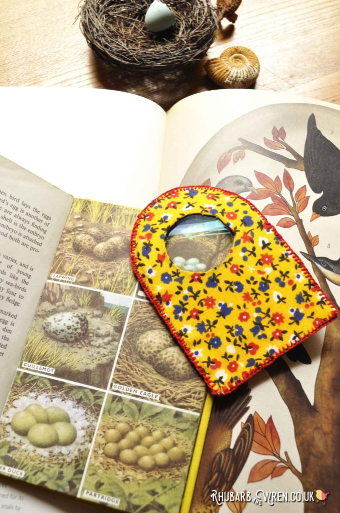 A yellow, fabric-covered, home-made magnifying glass
