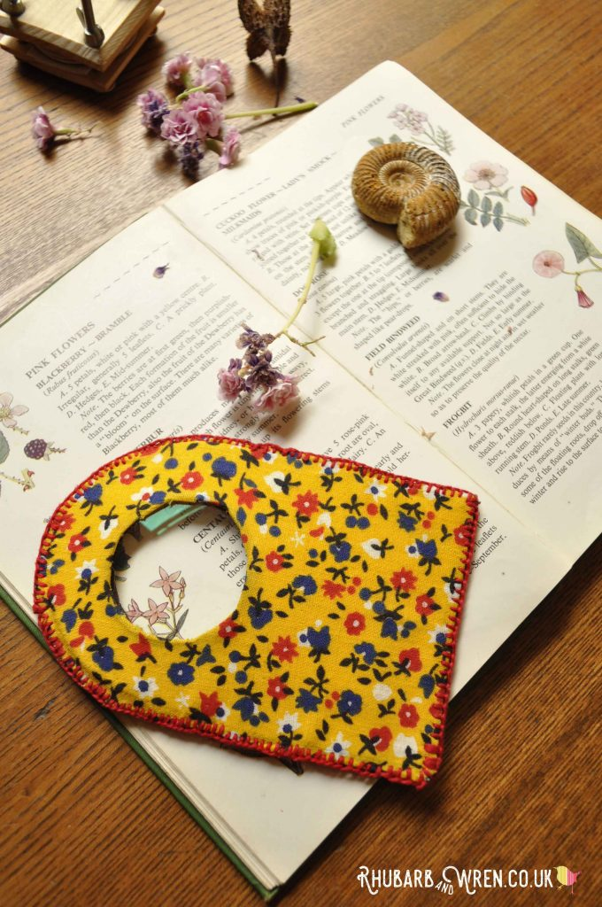 A home-made, fabric-covered, magnifying glass