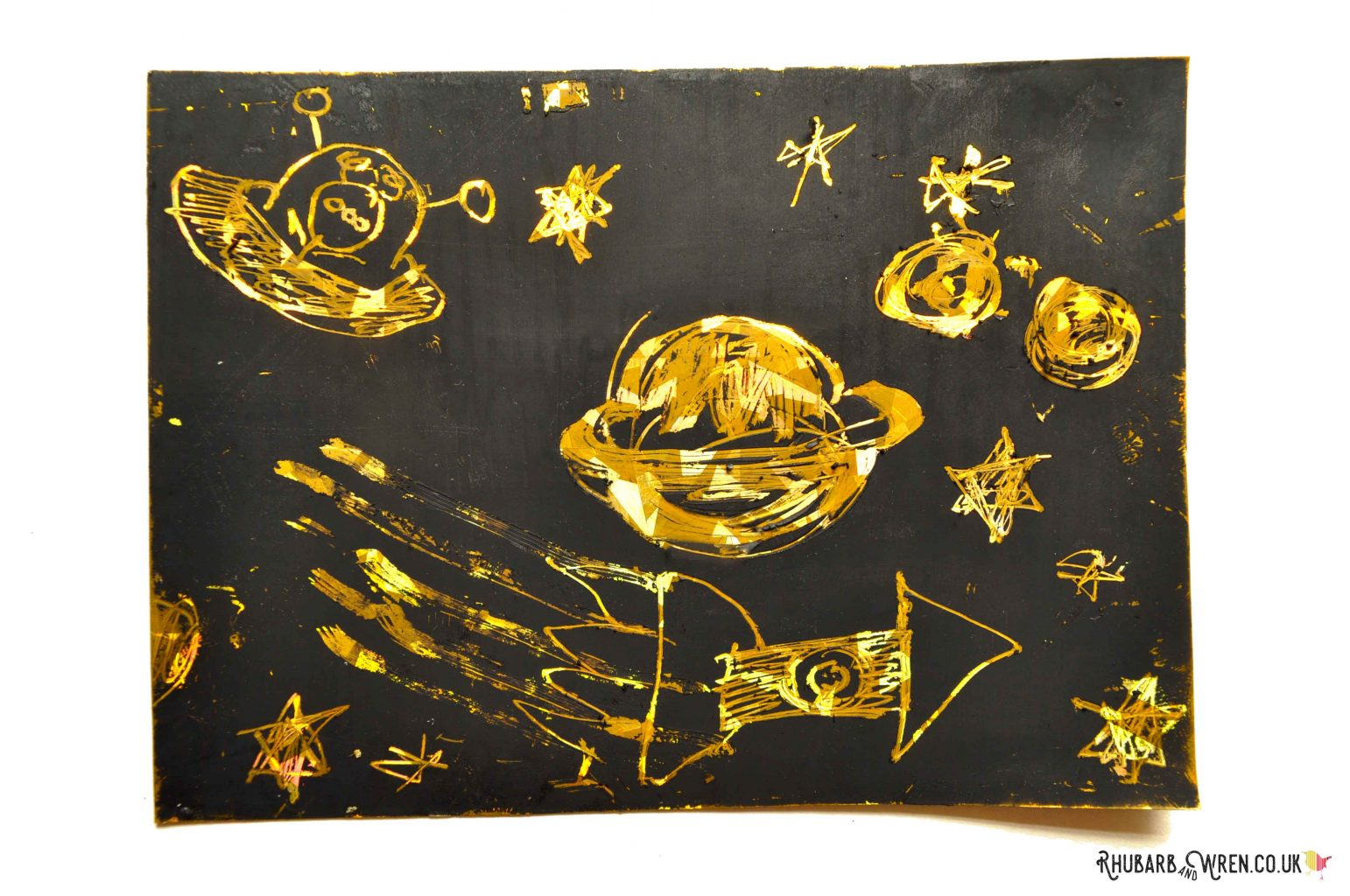 Child's drawing on holographic gold card diy scratch art board
