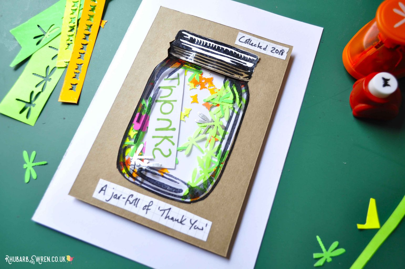 Home-made mason jar shaker card with paper punched shapes.