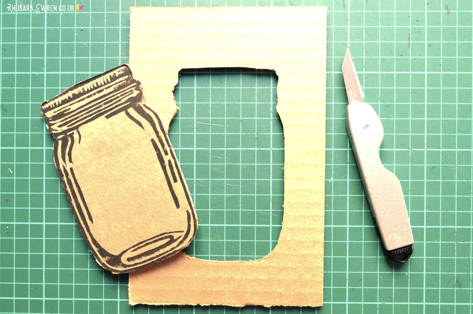 Cutting out cardboard to make a home-made mason jar shaker card
