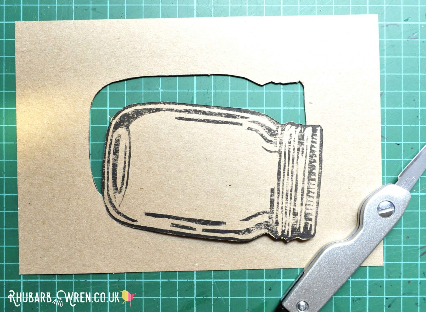 Cut out lino print of mason jar for shaker card project