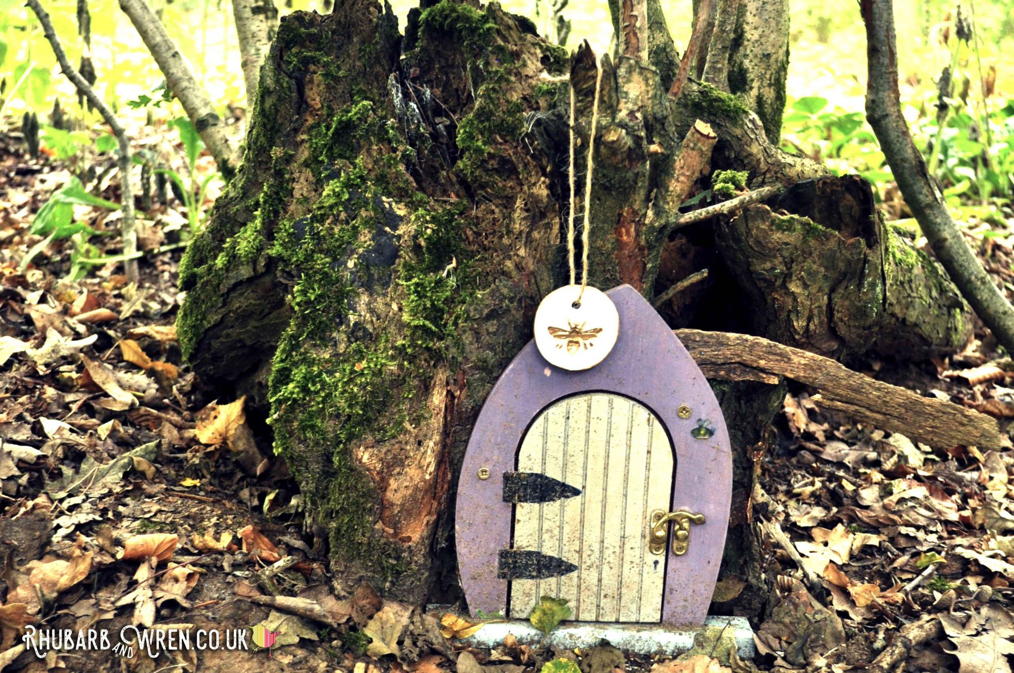 treasure hunt bee pendant on a fairy door in the woods