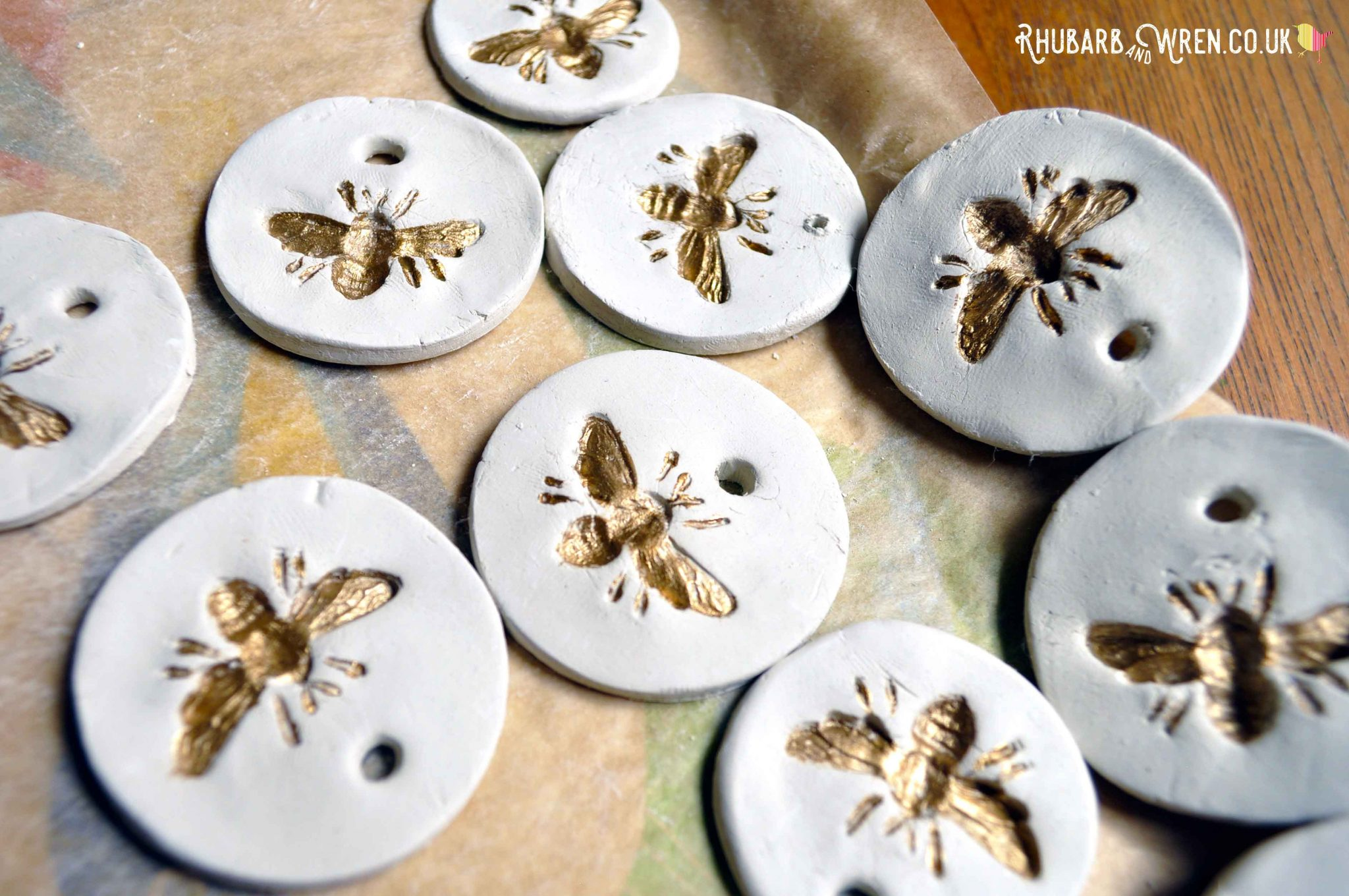 DIY air dry clay pendants painted gold for a treasure hunt