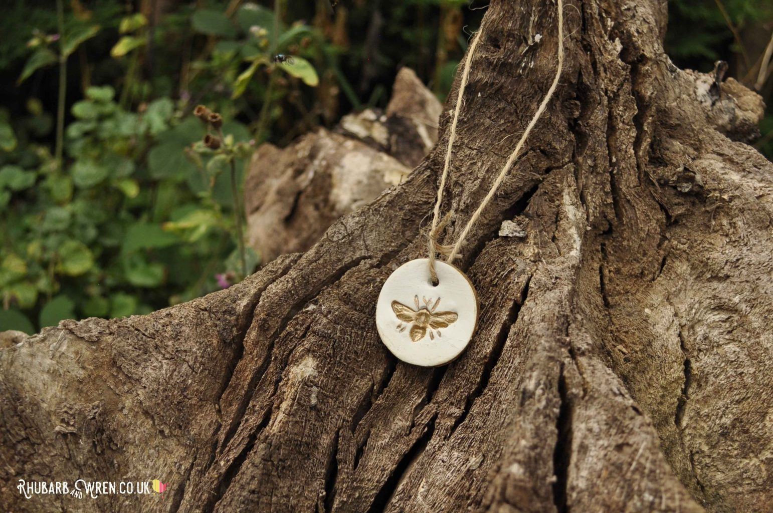 Golden bee diy air dry clay pendant on tree stump
