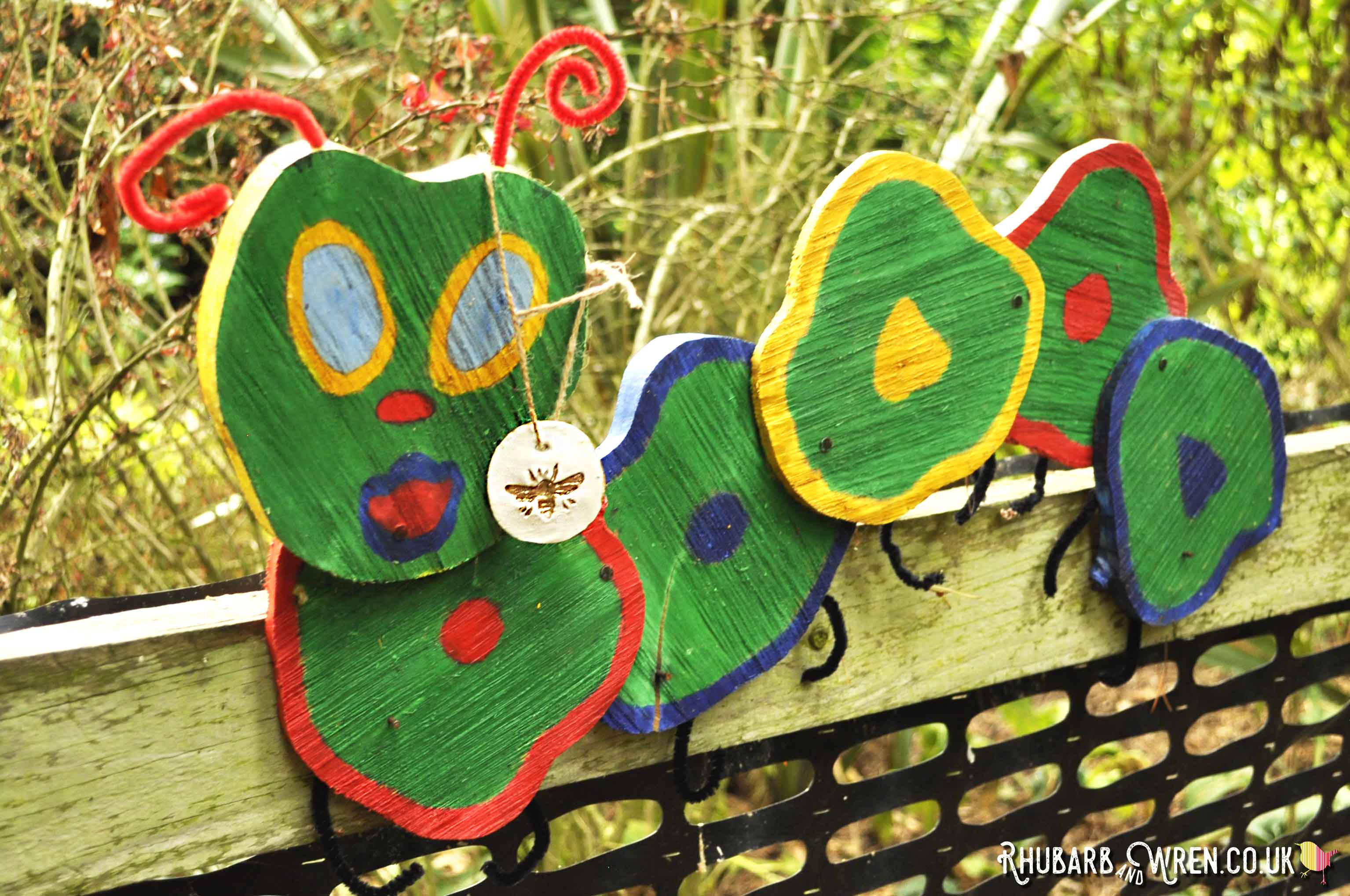 Wooden caterpillar decoration used in kids treasure hunt.
