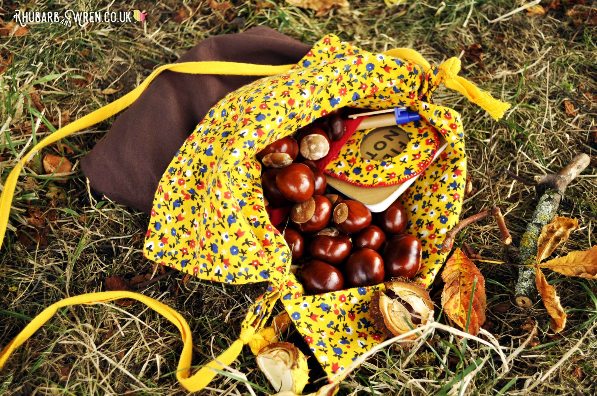 homemade diy nature explorer bag for kids, filled with conkers.