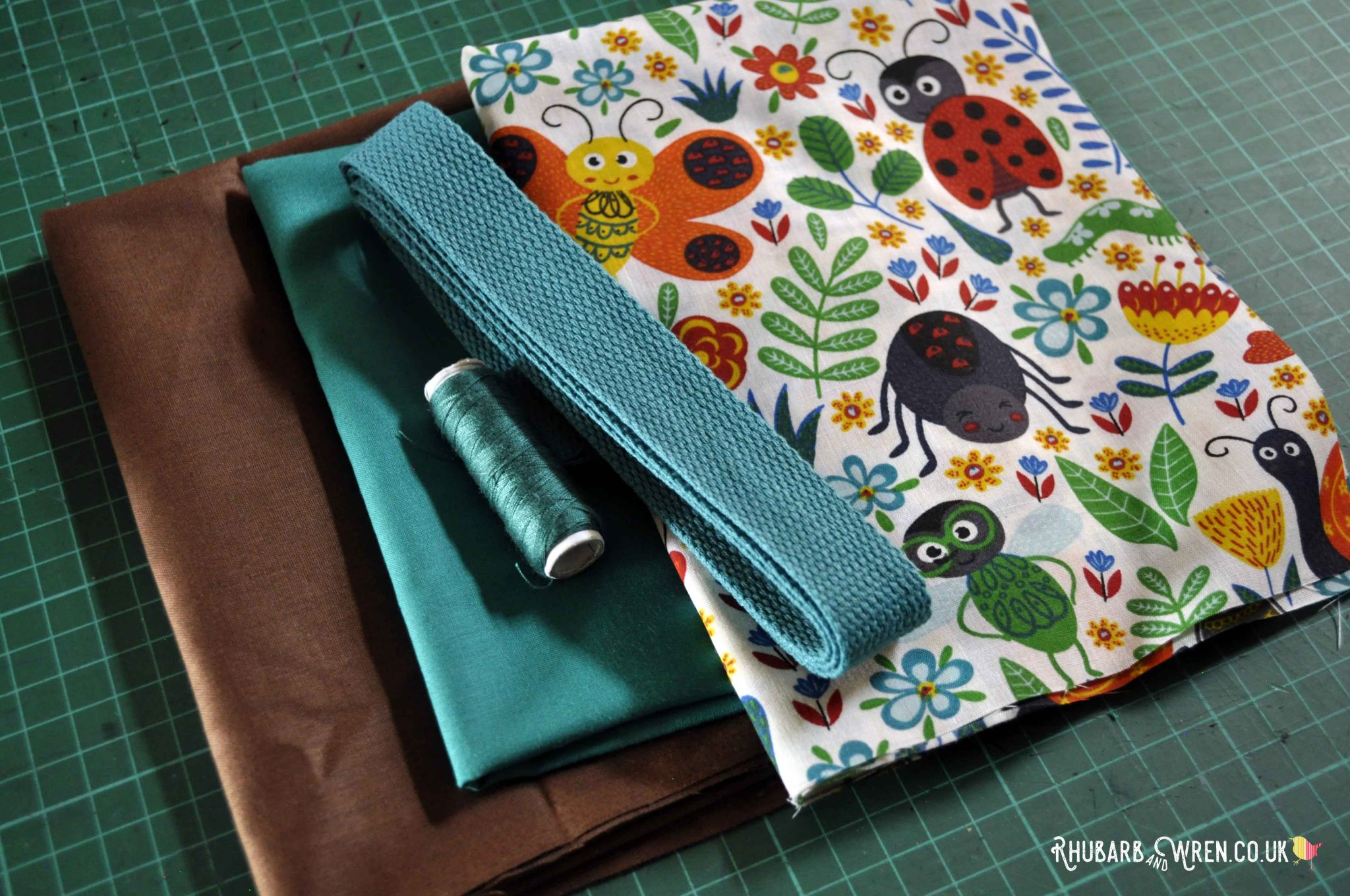 Fabric, webbing and thread for making a kids nature explorer bag.
