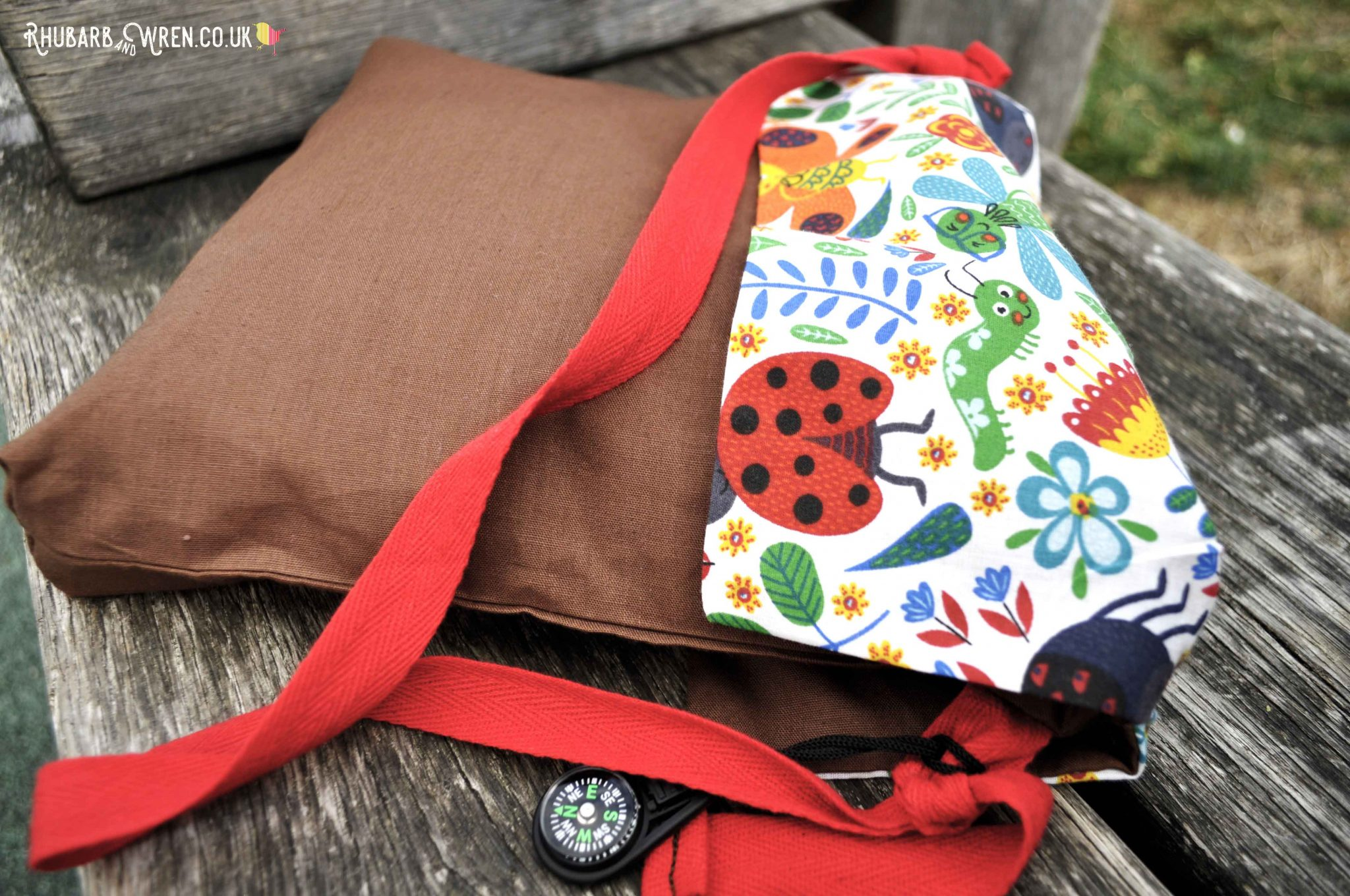 A homemade kids diy nature explorer bag with a mini compass