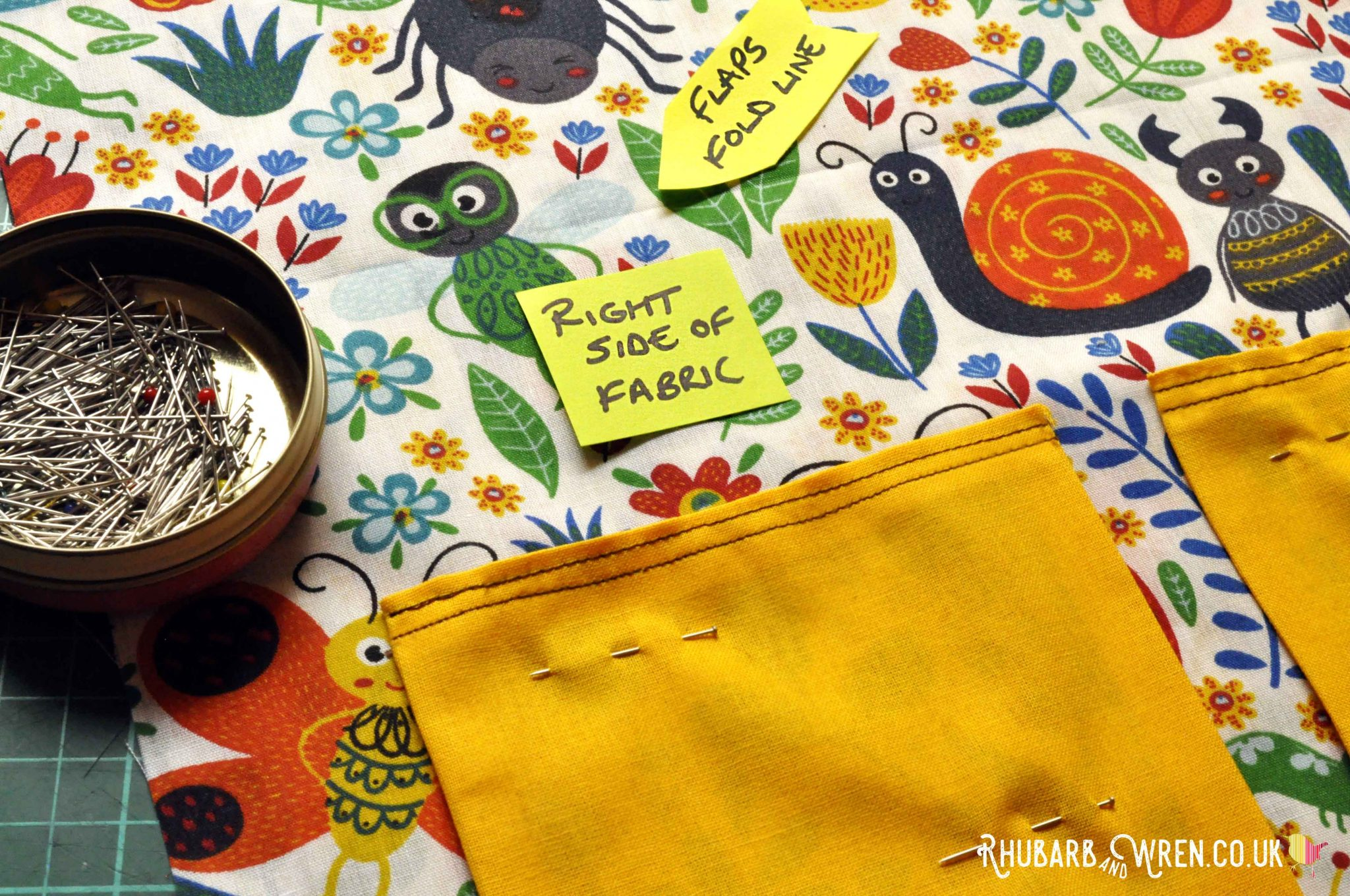 Pockets pinned in place on a diy nature explorer bag for kids.