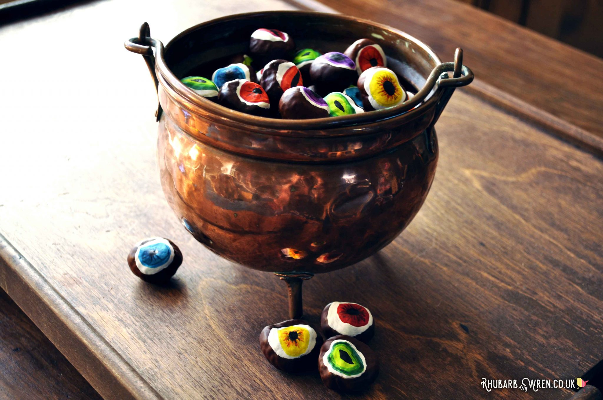 DIY conker eyeballs for Halloween decorations.