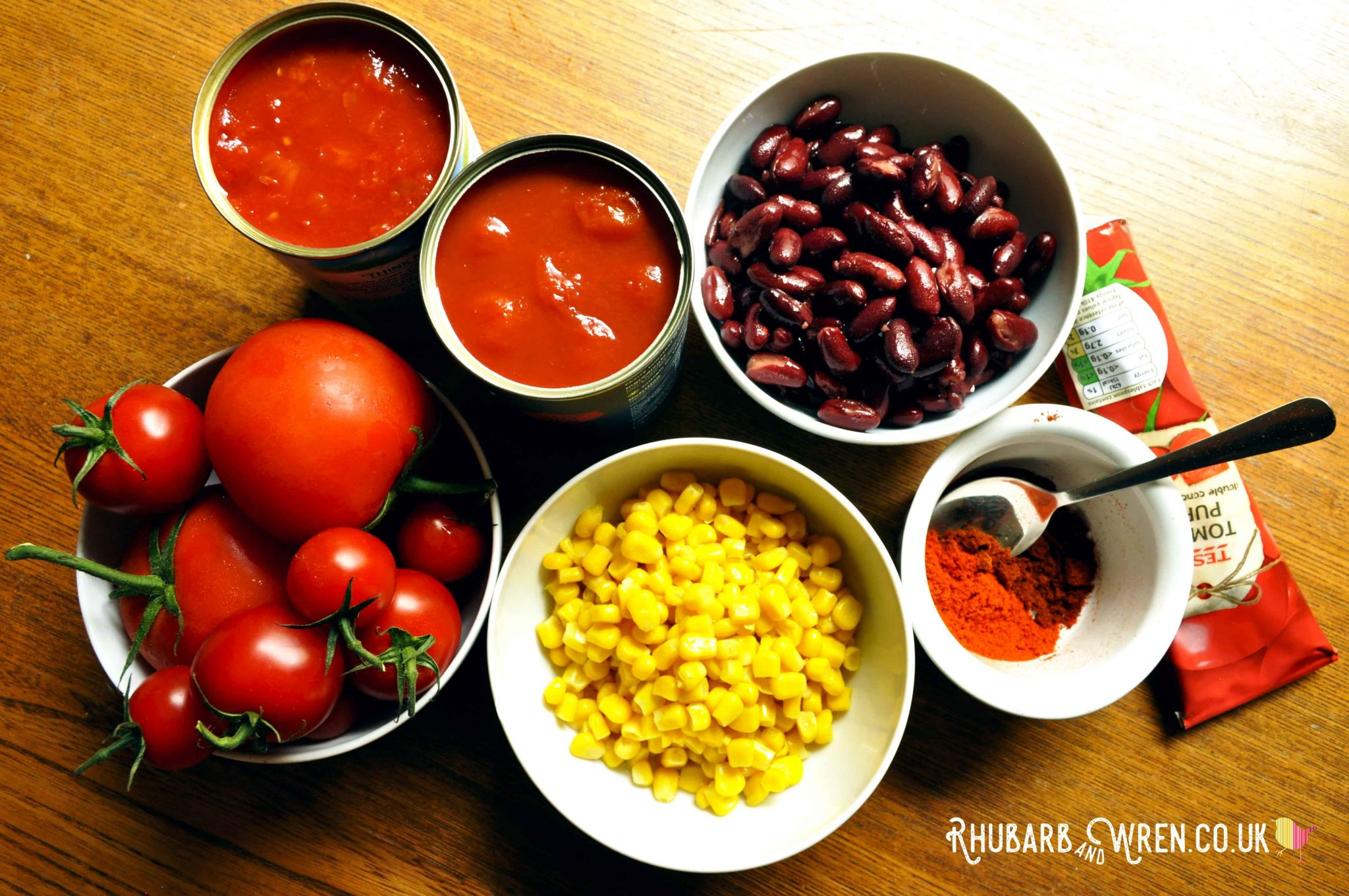 Tomatoes, sweetcorn, kidney beans and spices - ingredients for a vegan chili