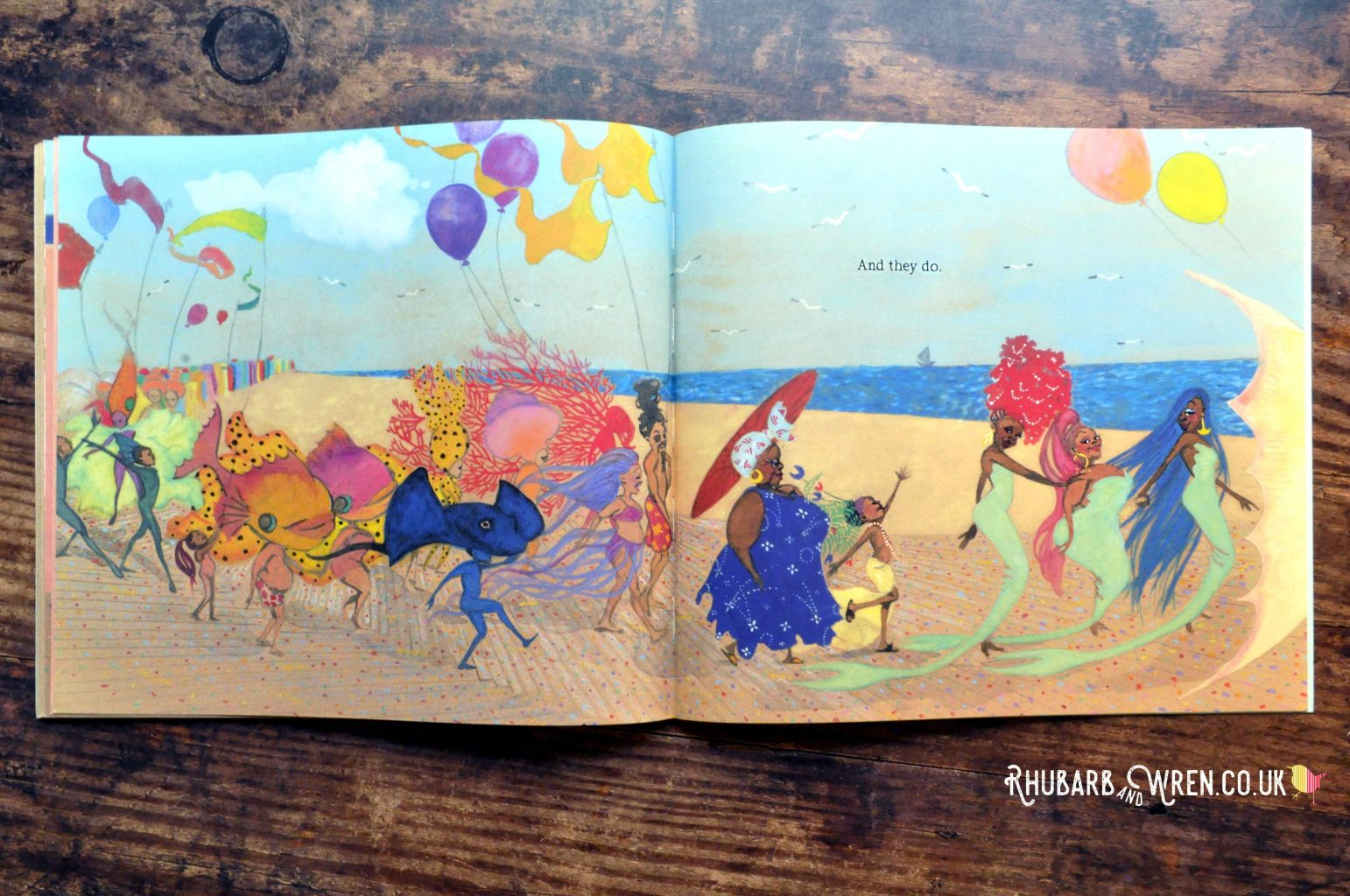 A page from the children's picture book 'Julian is a Mermaid' showing Julian dressed as a mermaid and taking part in the Coney Island Mermaid Parade.
