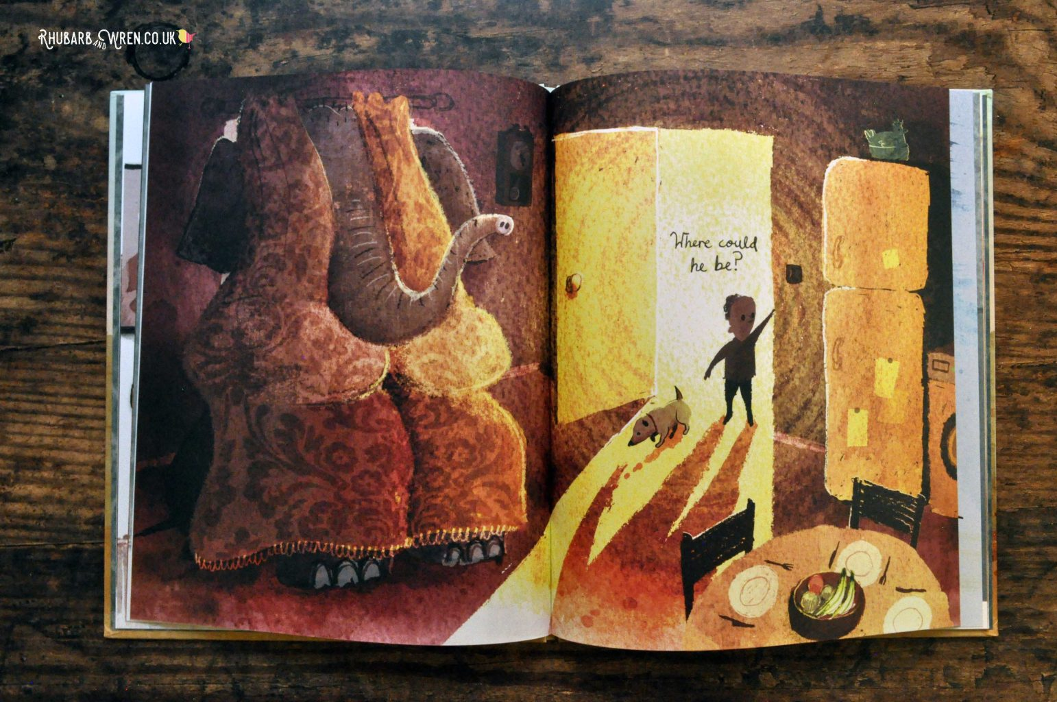 A page from 'Have You Seen Elephant' by David Barrow, where the elephant is hiding, very obviously, behind a pair of curtains.