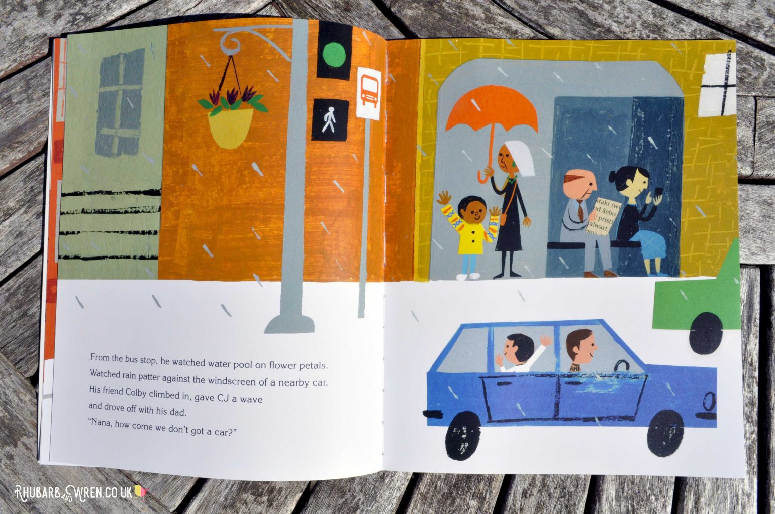 CJ and Nana wait at the bus stop in a page from Last Stop on Market Street - picture book by Matt de la Pena and Christian Robinson