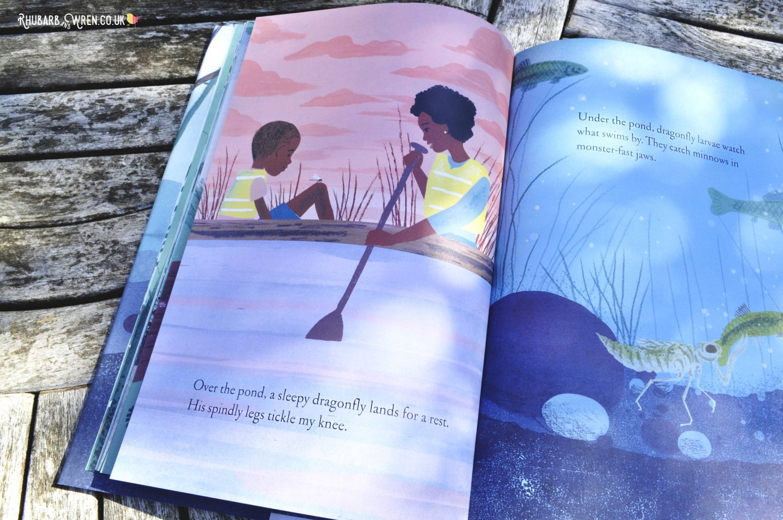 Page from Over and Under the Pond - mother and son paddling home in their boat