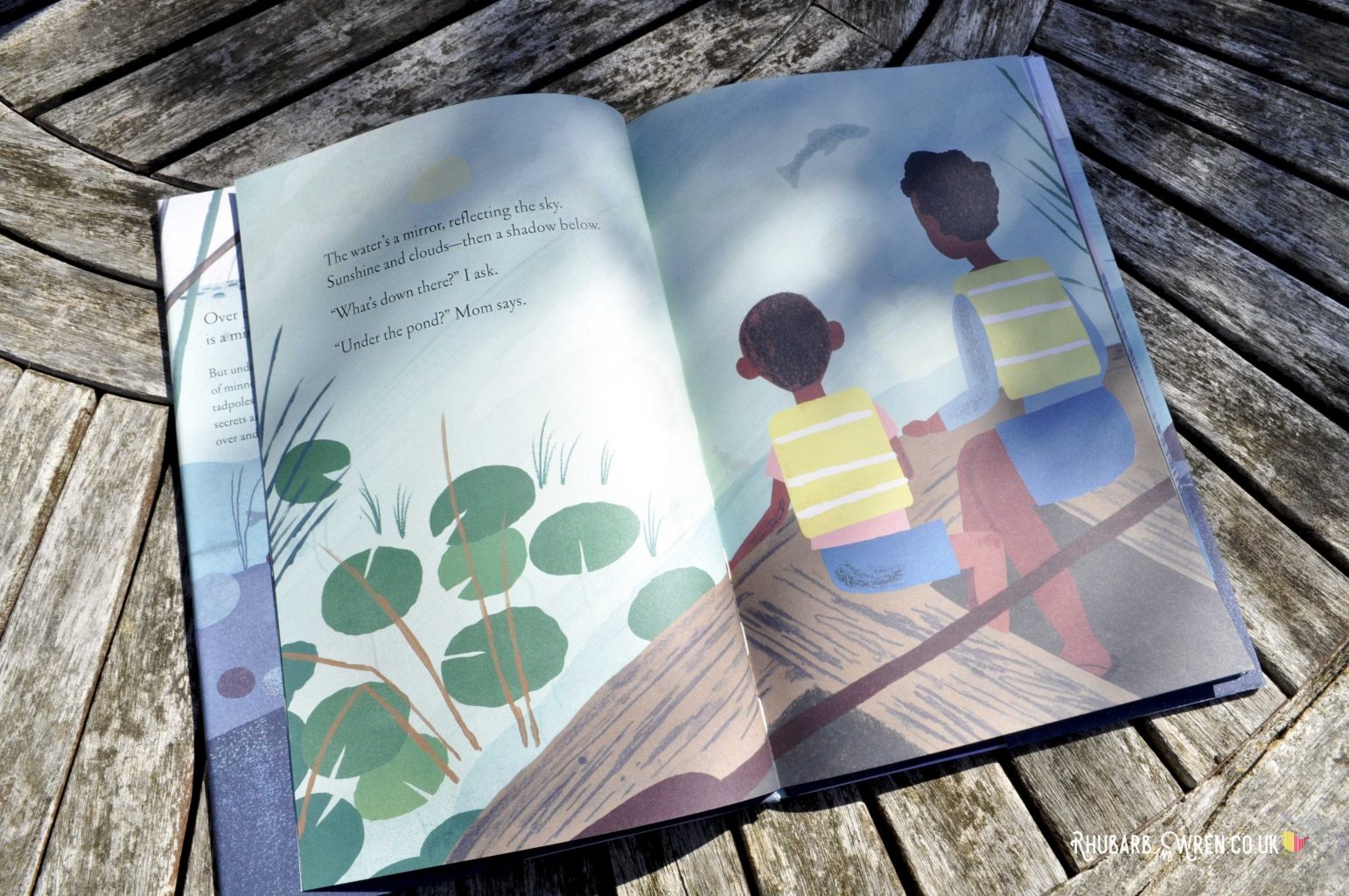 Page from Over and Under the Pond - a boy and his mother looking into the water