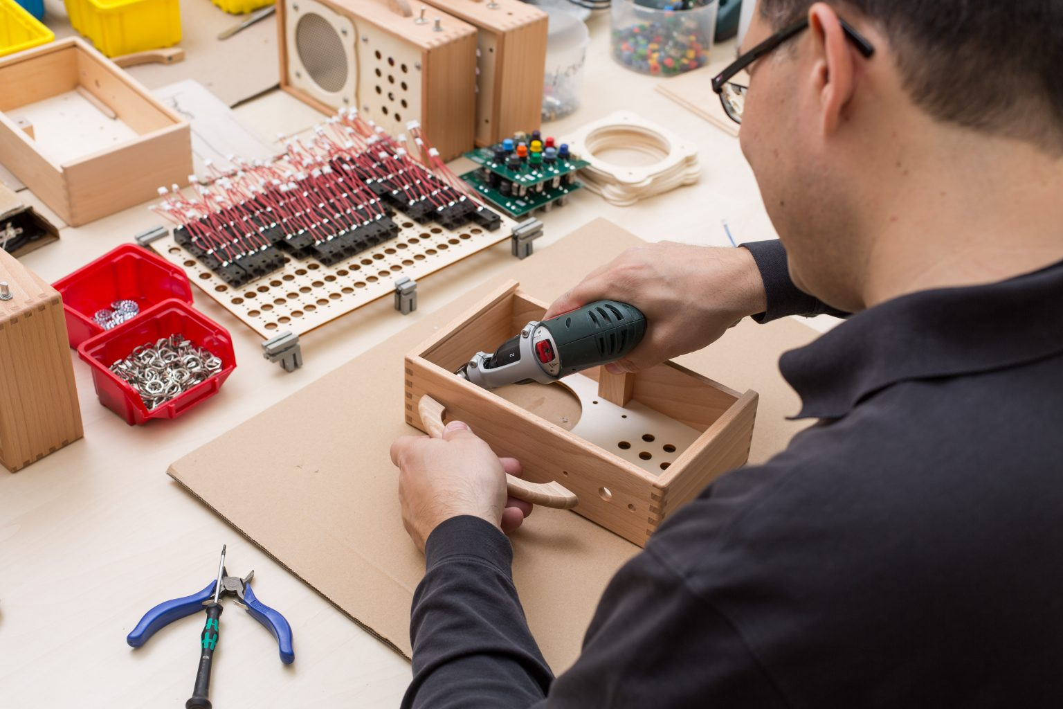 man assembling a Horbert MP3 player in the factory in Germany