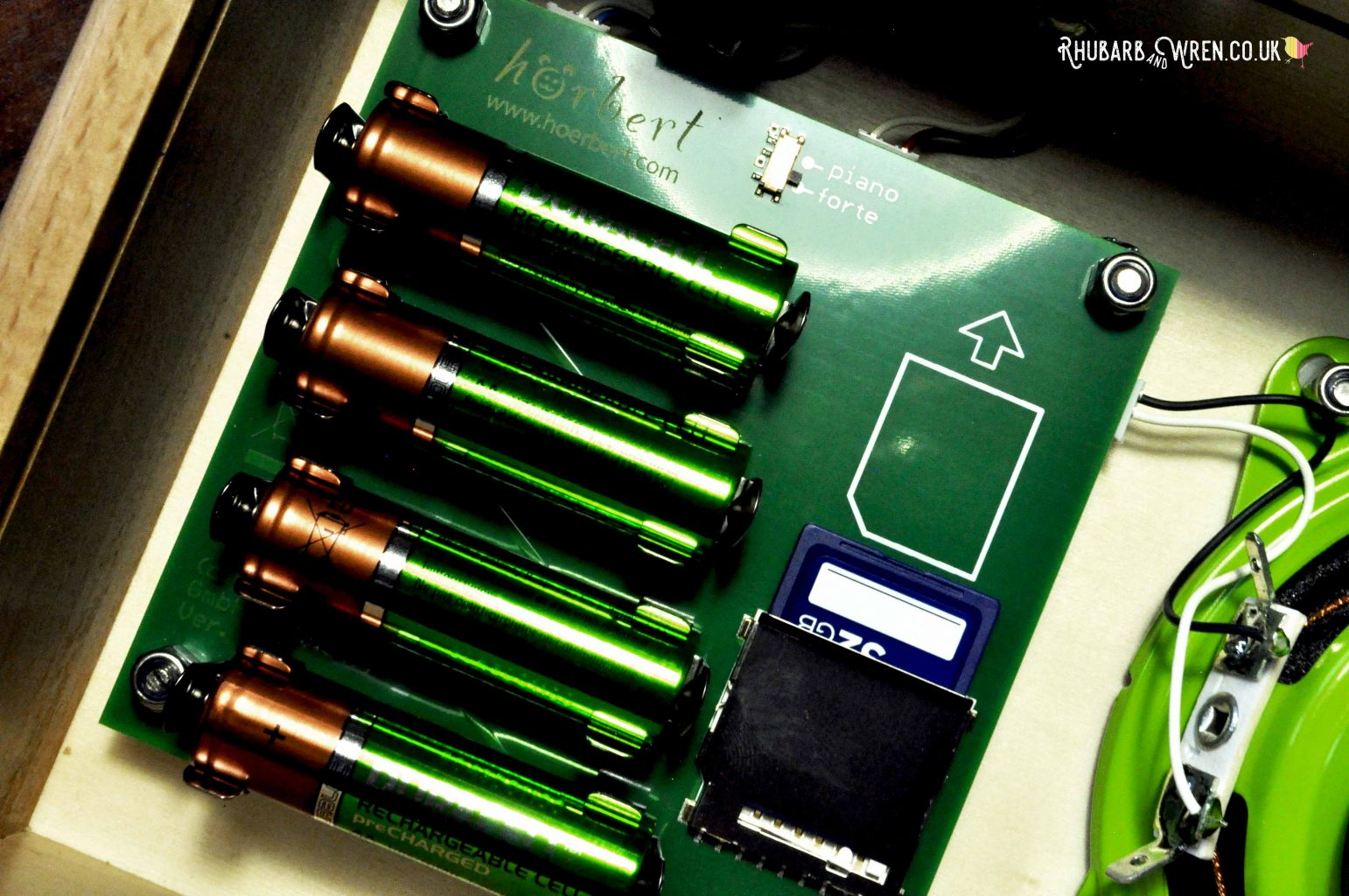 Close-up of battery rack, SD card slot and volume controller, inside Horbert MP3 player