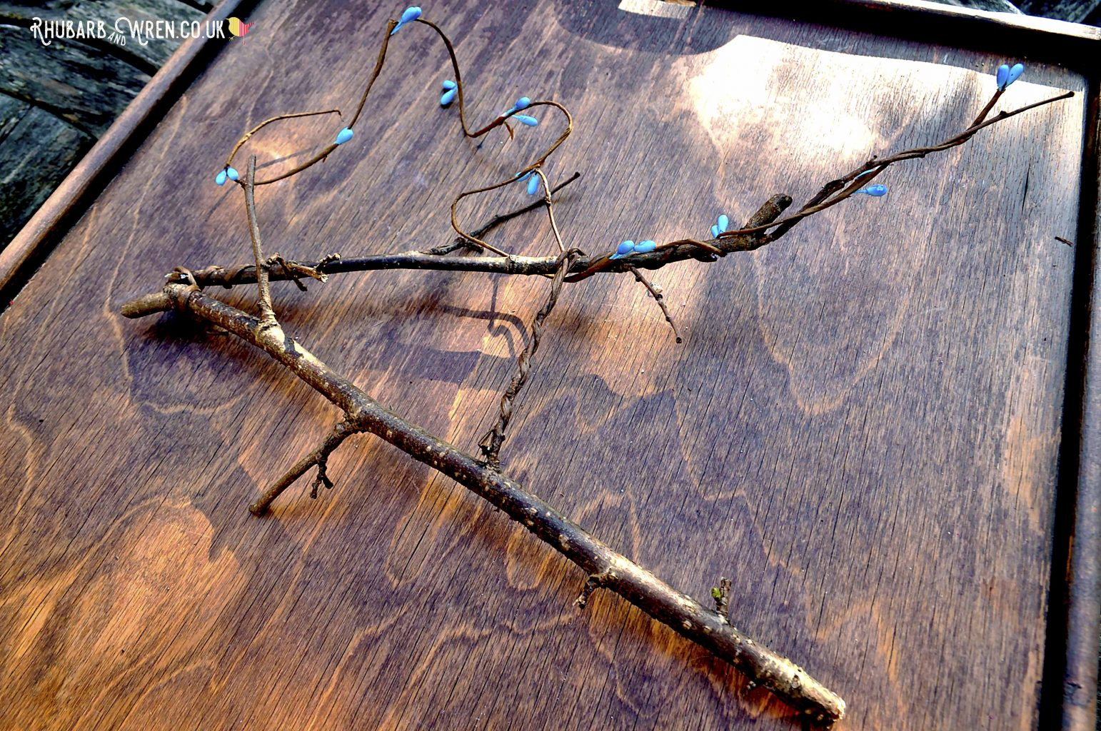 Use florist pip berry wire to decorate DIY twig letters